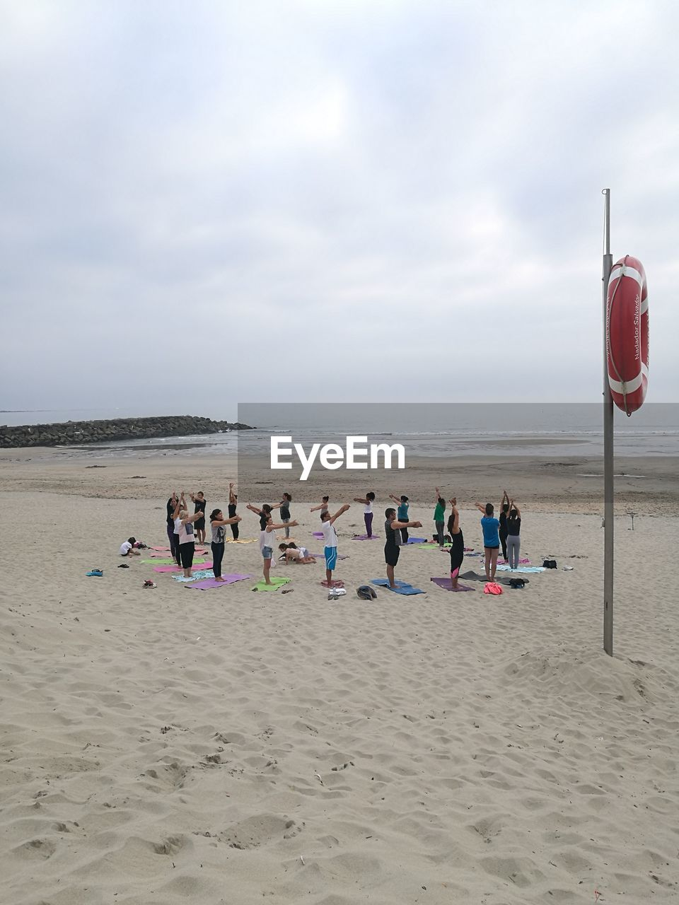 People exercising at beach