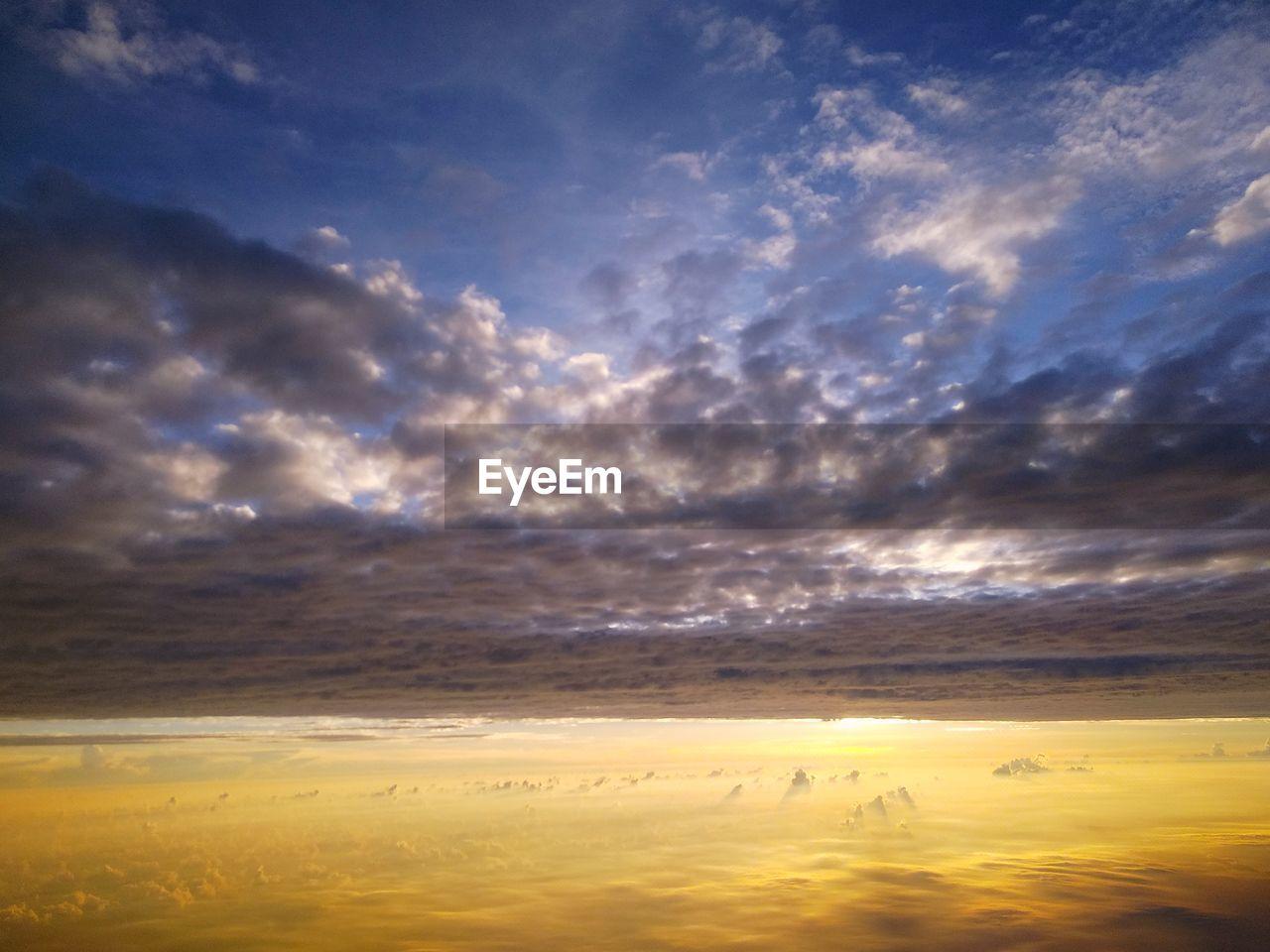 cloud - sky, sky, scenics - nature, beauty in nature, tranquility, tranquil scene, sunset, nature, no people, idyllic, dramatic sky, outdoors, cloudscape, environment, non-urban scene, sunlight, orange color, horizon, landscape