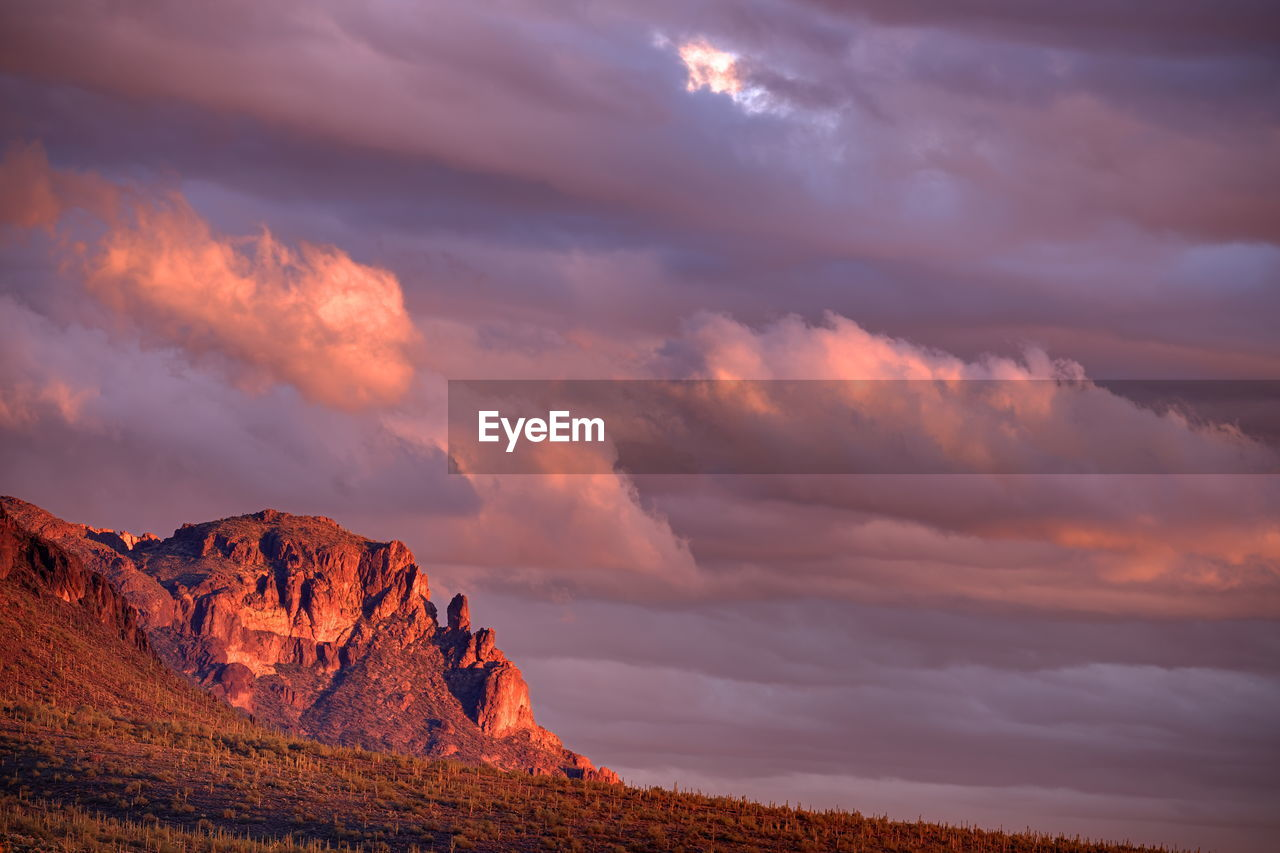 SCENIC VIEW OF DRAMATIC SKY OVER LANDSCAPE DURING SUNSET