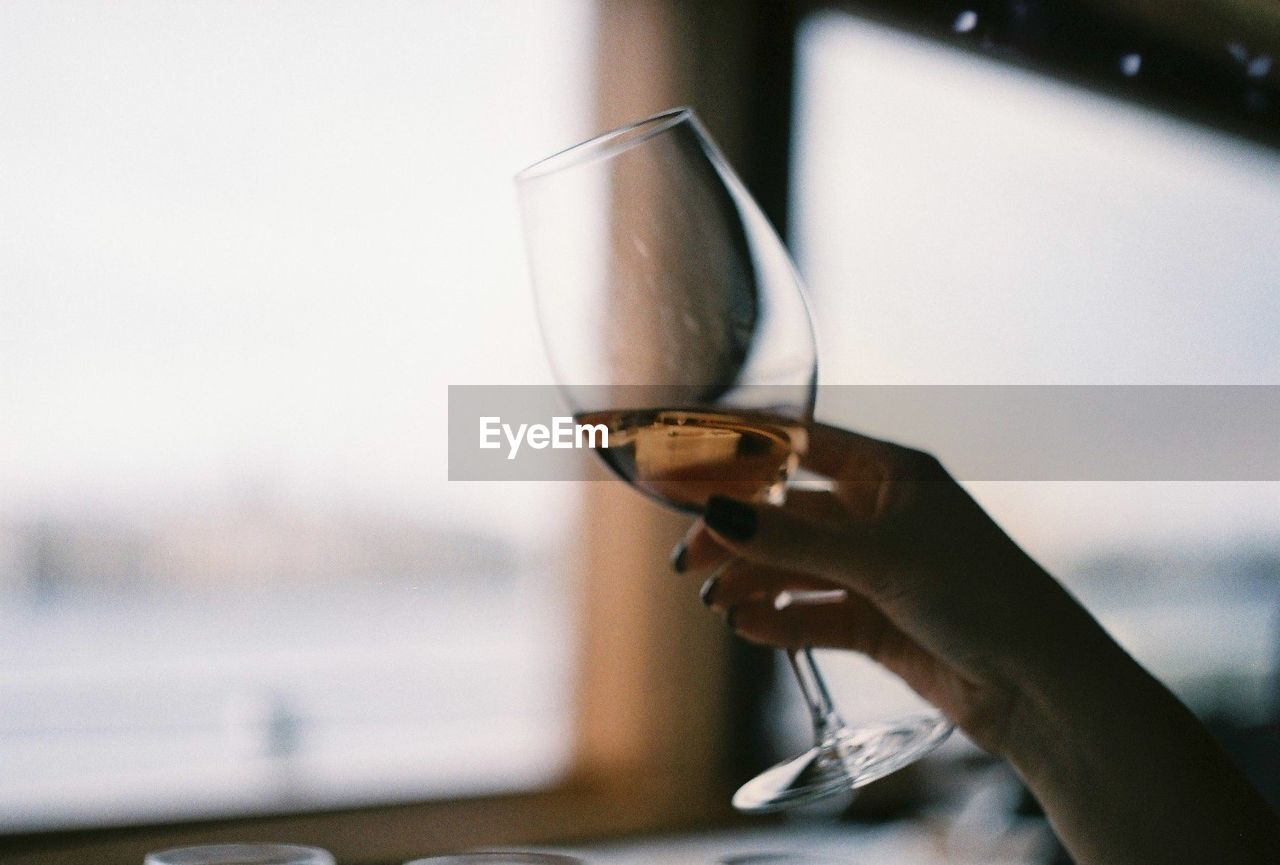 Cropped Image Of Woman Holding Wineglass