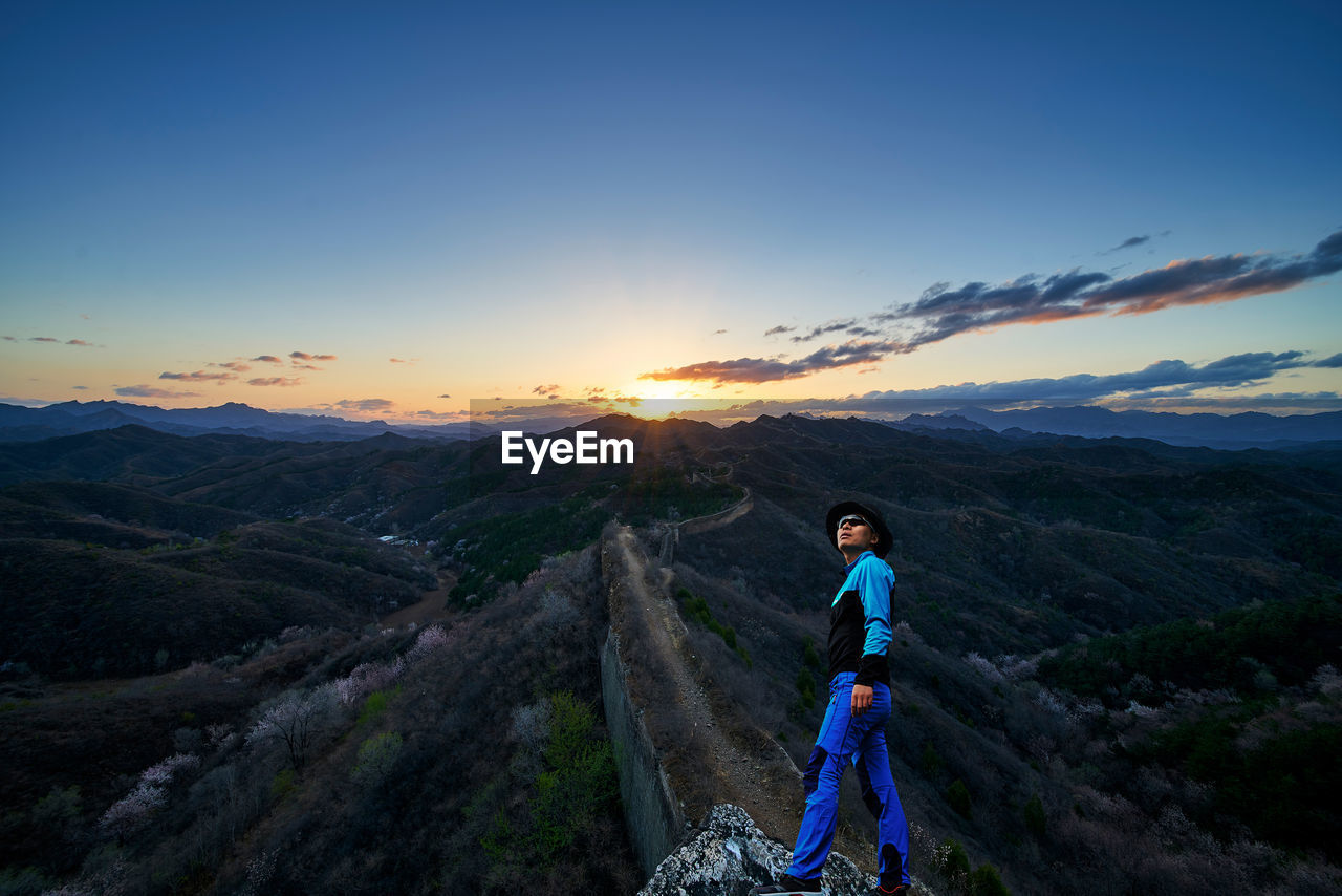 Man At Great Wall Of China Against Sky During Sunrise