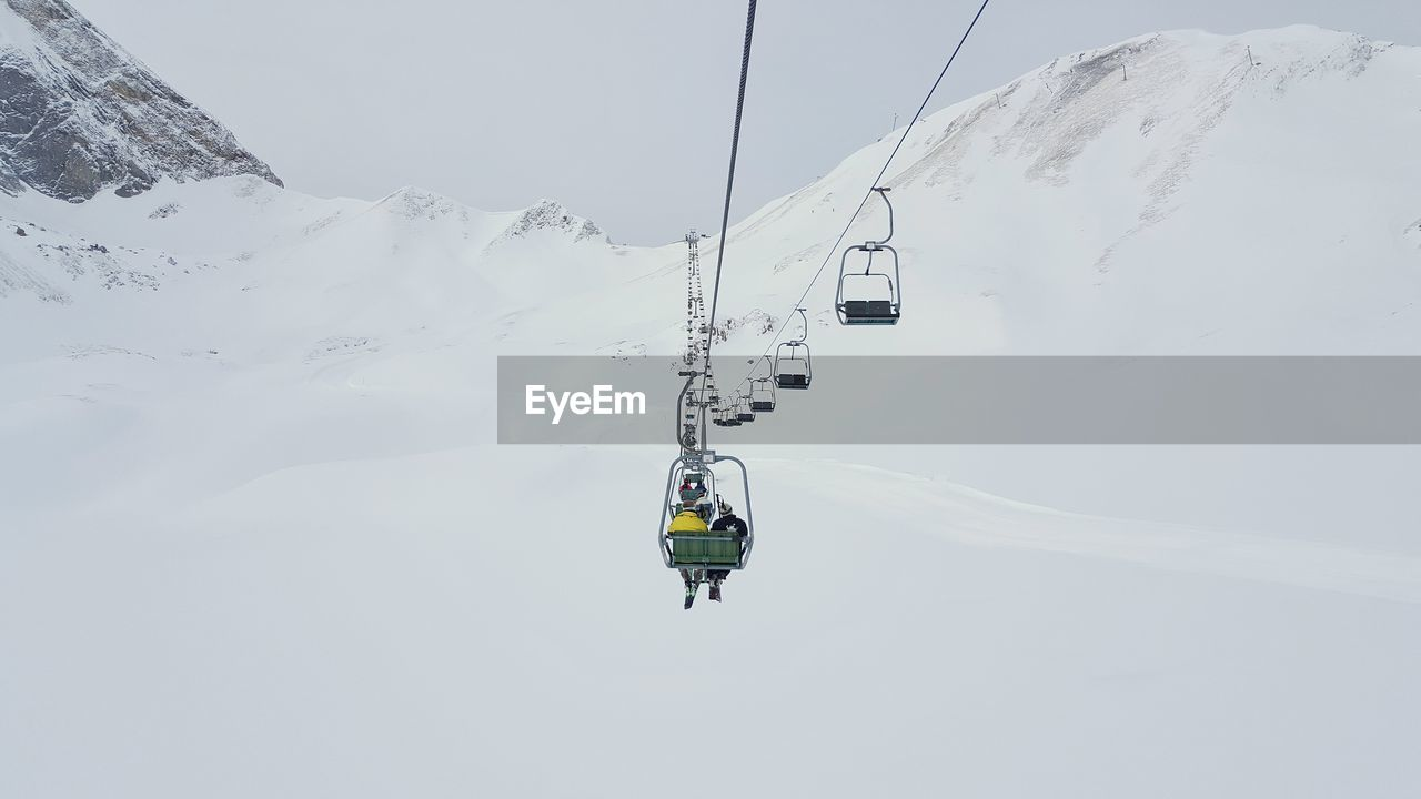 Overhead Cable Cars Over Snowy Field During Winter