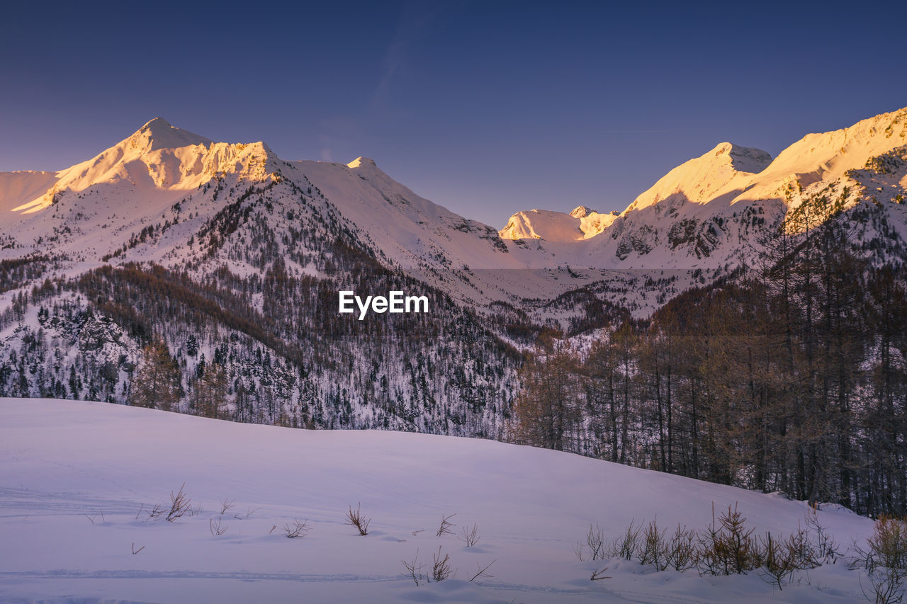 Sunrise over the snow capped mountains of les orres, hautes alpes, france