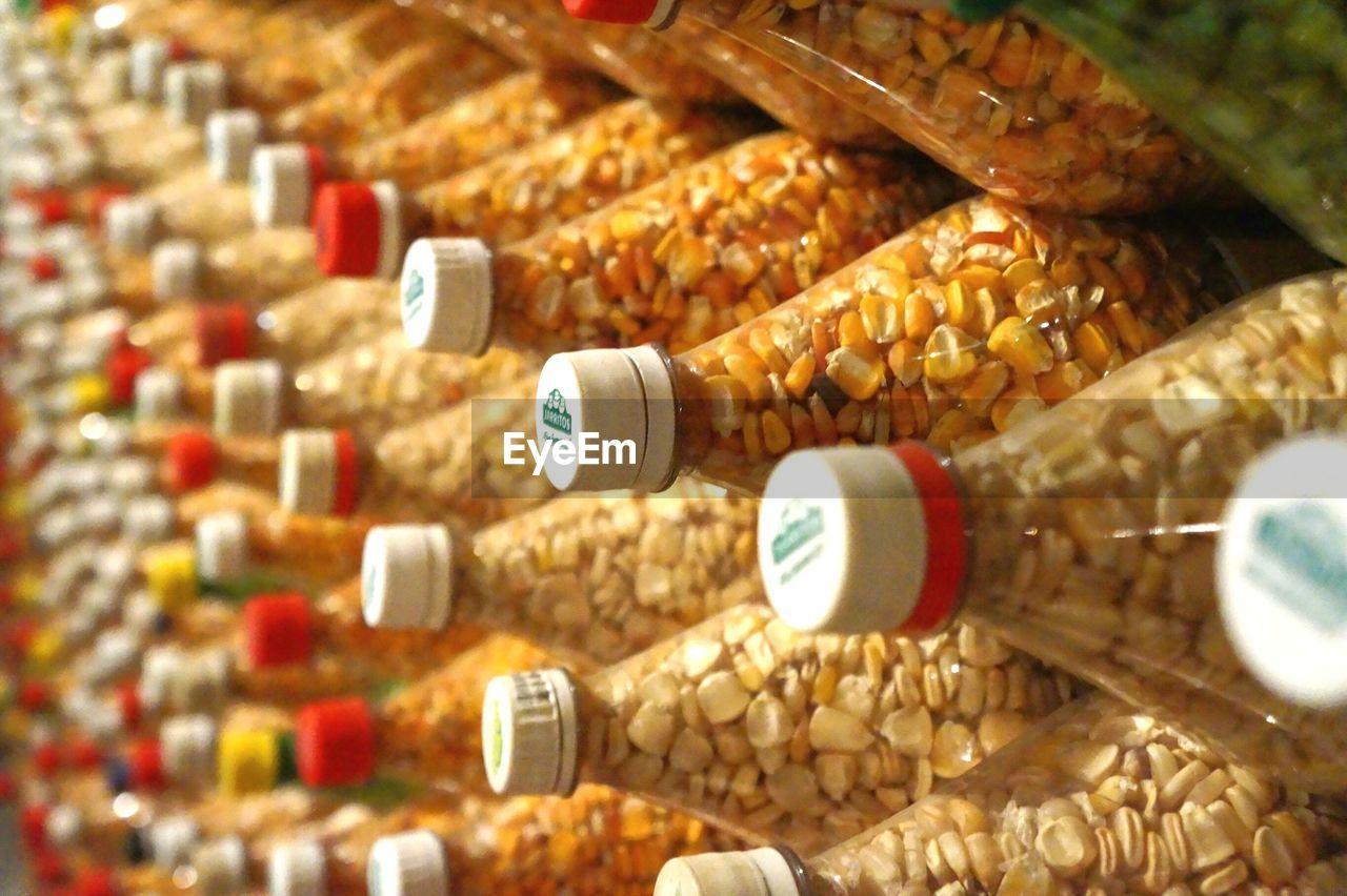 Detail Shot Of Corns In Bottles