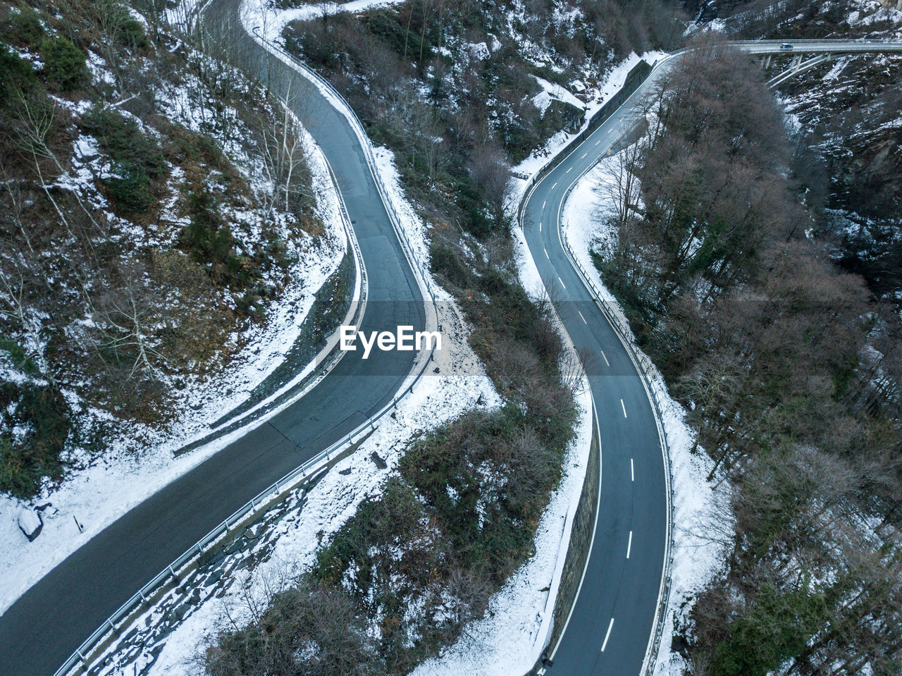 road, curve, no people, transportation, scenics - nature, high angle view, winding road, nature, beauty in nature, mountain road, plant, cold temperature, day, tree, connection, direction, snow, outdoors, motion, winter