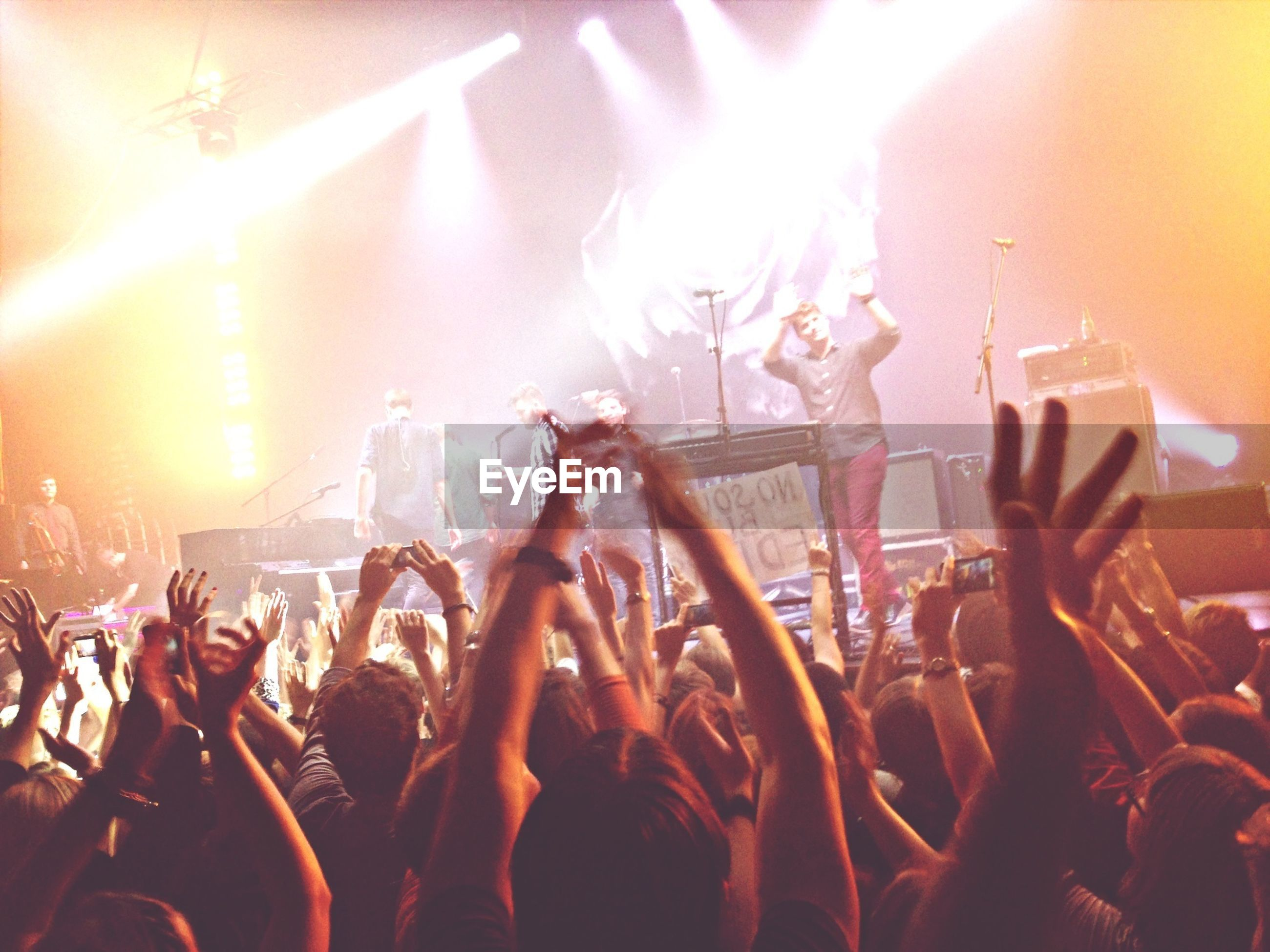 large group of people, crowd, enjoyment, lifestyles, arts culture and entertainment, performance, music, fun, event, leisure activity, person, nightlife, illuminated, popular music concert, celebration, concert, men, music festival