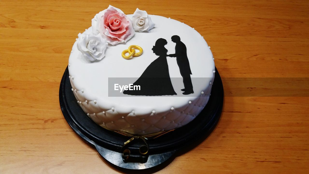 sweet food, sweet, cake, dessert, indulgence, food and drink, food, still life, indoors, temptation, baked, representation, table, freshness, unhealthy eating, ready-to-eat, no people, close-up, human representation, high angle view, wedding cake