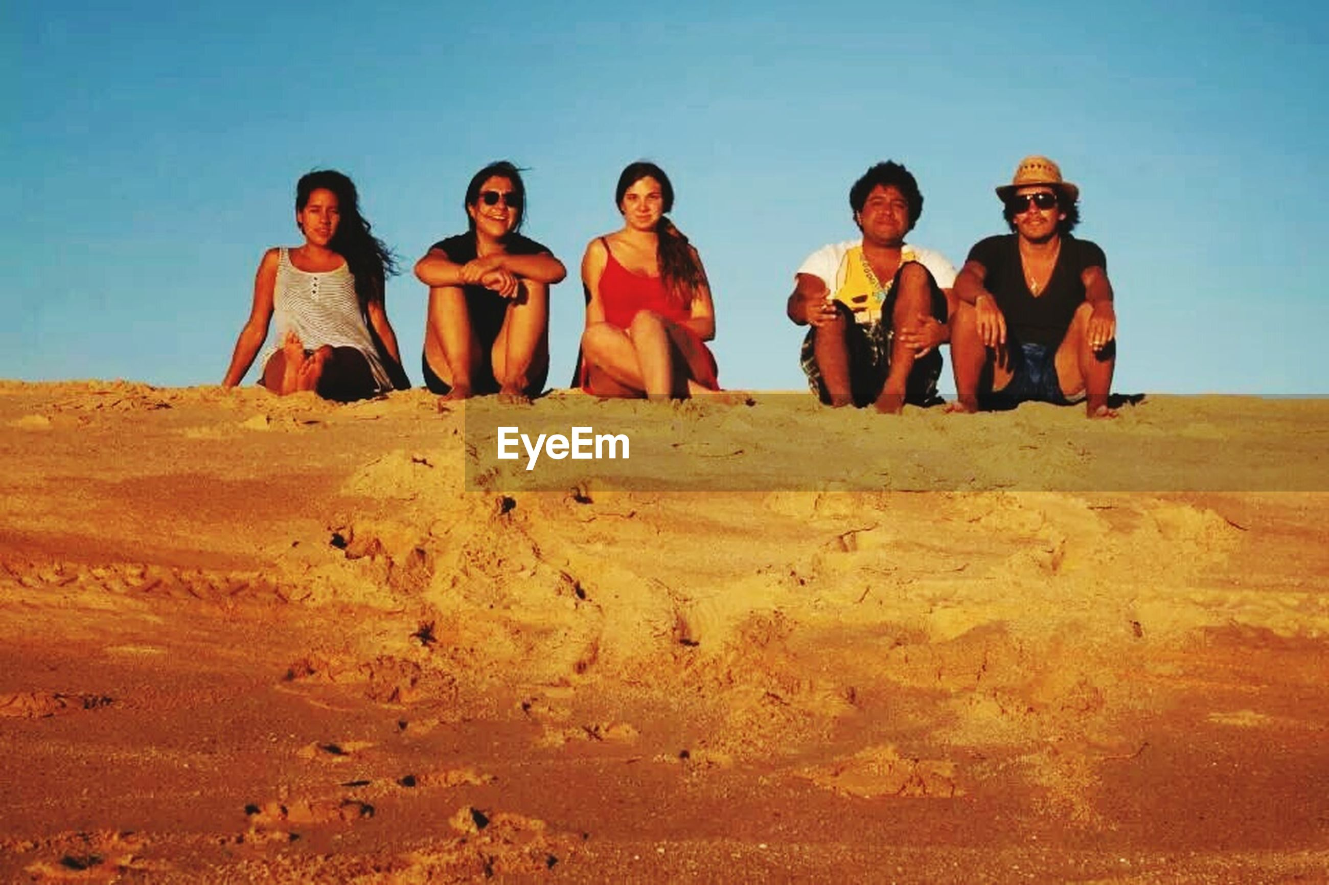 lifestyles, leisure activity, sand, togetherness, full length, clear sky, casual clothing, young men, person, bonding, vacations, desert, men, beach, love, sunlight, sky, friendship