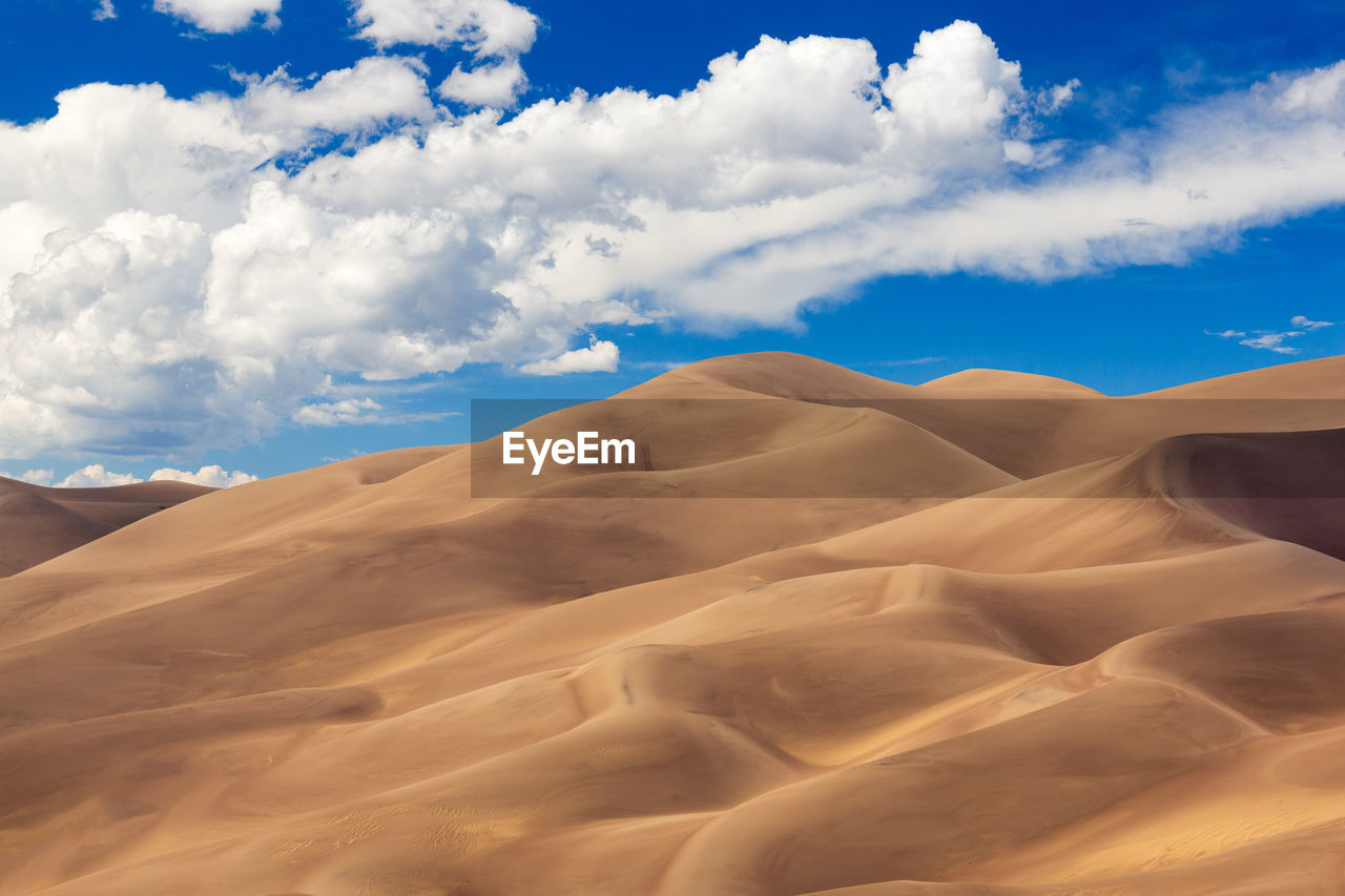 scenics - nature, desert, cloud - sky, sand dune, beauty in nature, landscape, sky, climate, tranquility, arid climate, tranquil scene, sand, environment, land, non-urban scene, nature, remote, no people, physical geography, extreme terrain, outdoors
