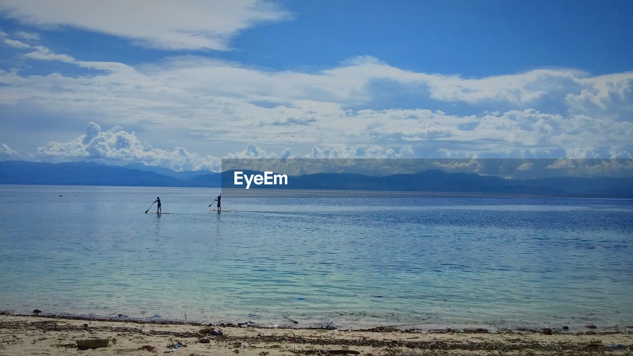 water, sea, sky, nature, scenics, cloud - sky, beauty in nature, tranquility, tranquil scene, outdoors, blue, beach, day, horizon over water, paddleboarding, no people