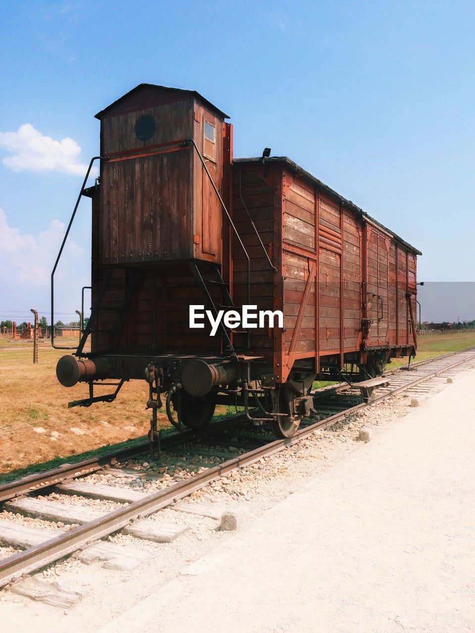sky, rail transportation, transportation, track, railroad track, train, mode of transportation, day, nature, train - vehicle, abandoned, rusty, land, business, sunlight, no people, old, clear sky, outdoors, metal, deterioration, shunting yard, railroad car
