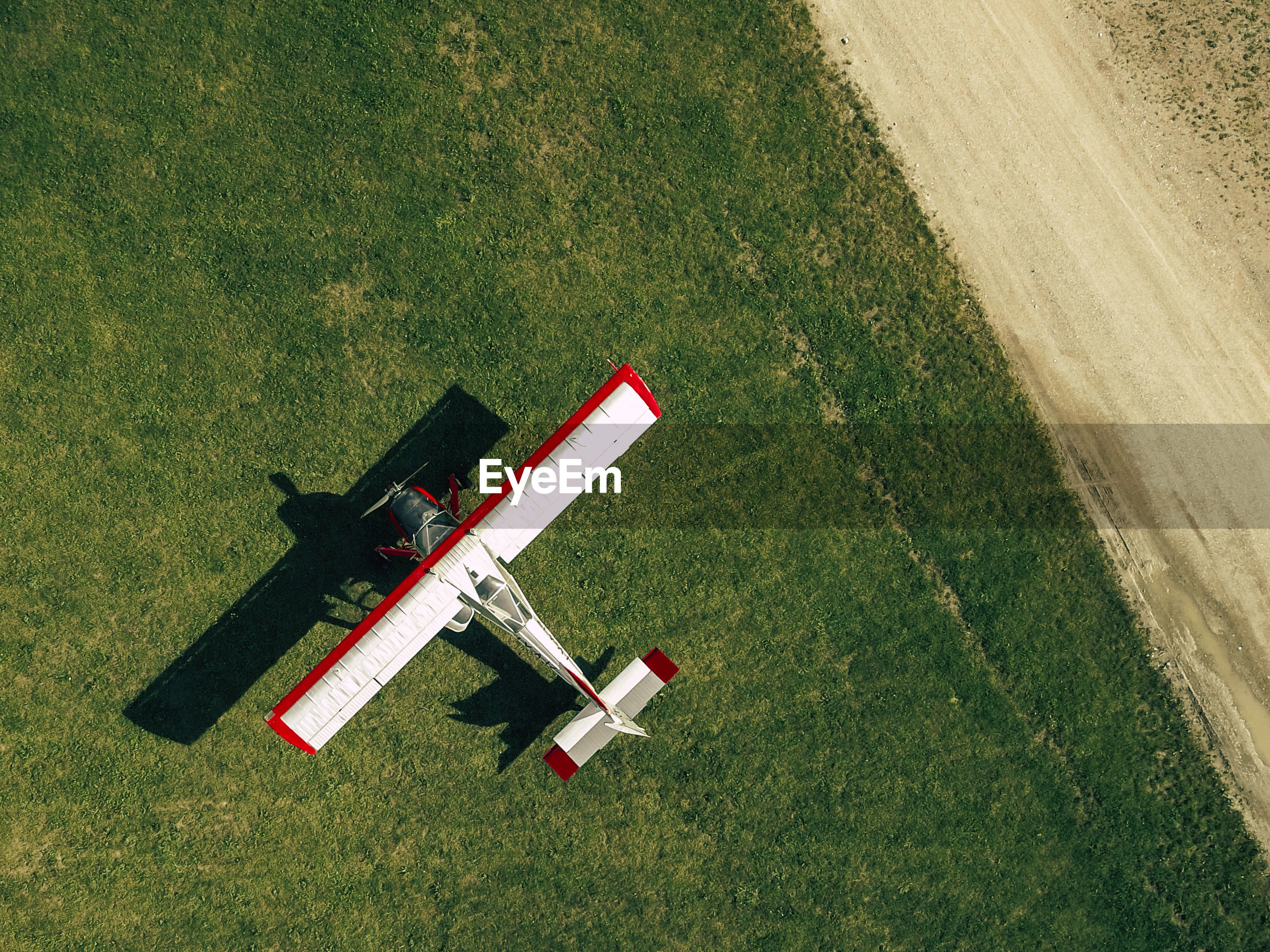 Directly above shot of biplane on grassy field