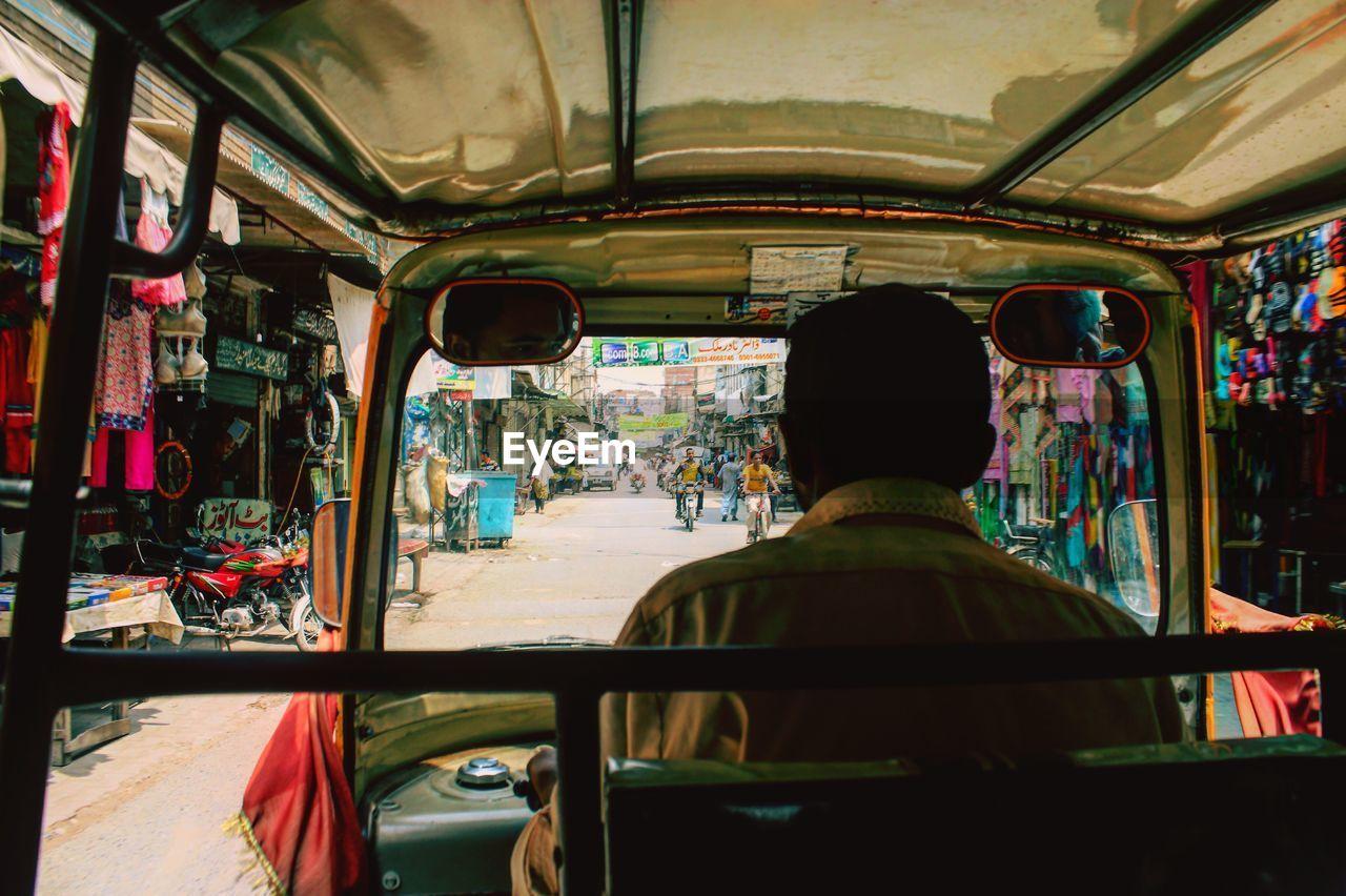 Rear View Of Driver Driving Rickshaw