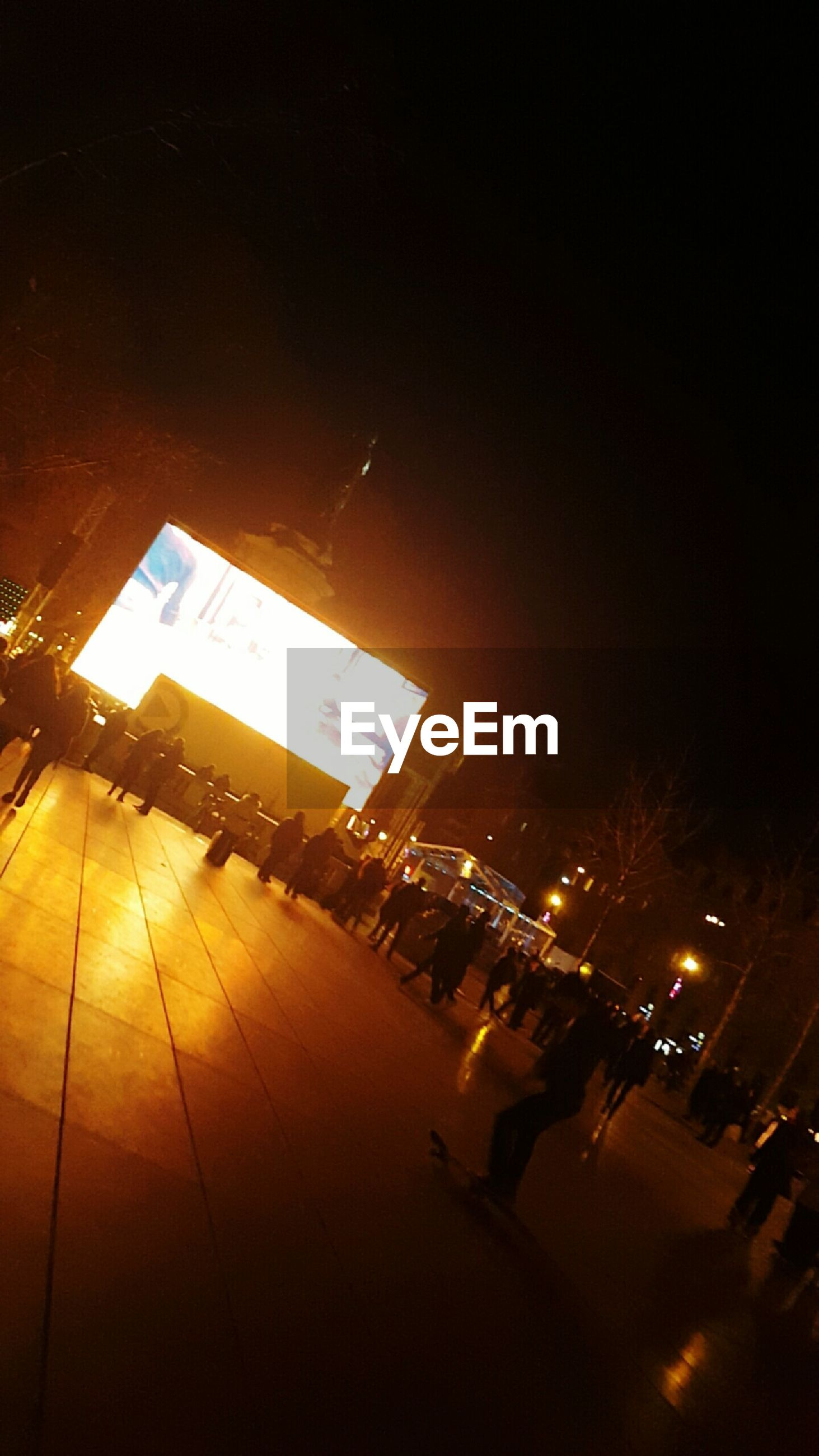 illuminated, night, building exterior, architecture, built structure, city, city life, street, text, sky, high angle view, communication, lighting equipment, outdoors, building, city street, large group of people, low angle view, light - natural phenomenon, copy space
