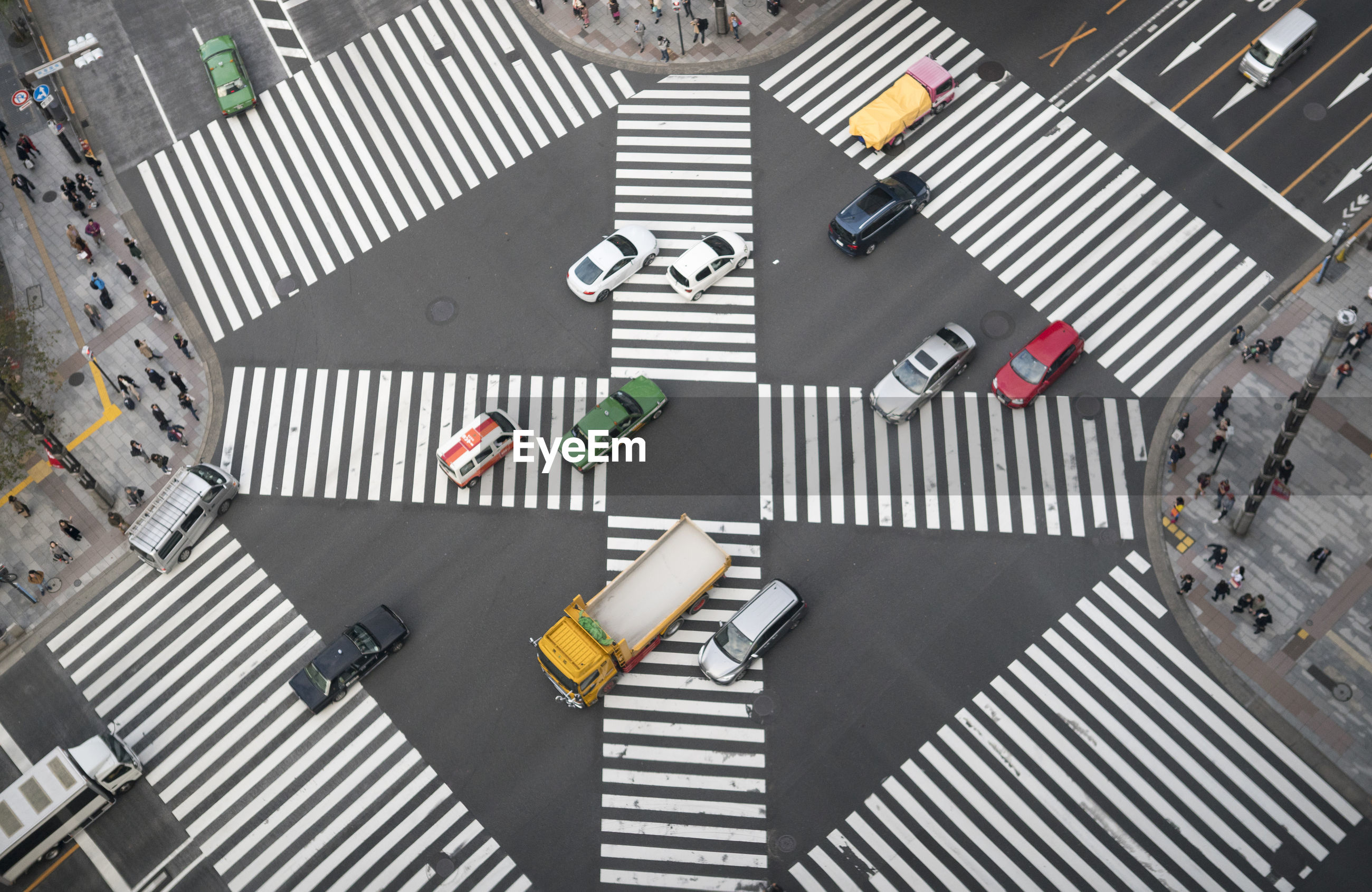 High angle view of vehicles on zebra crossing in city
