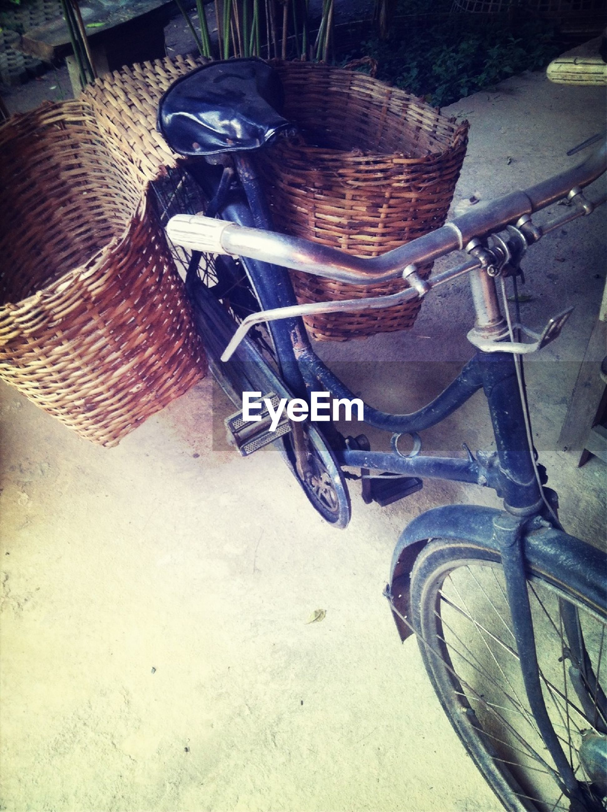 High angle view of baskets hanging on bicycle