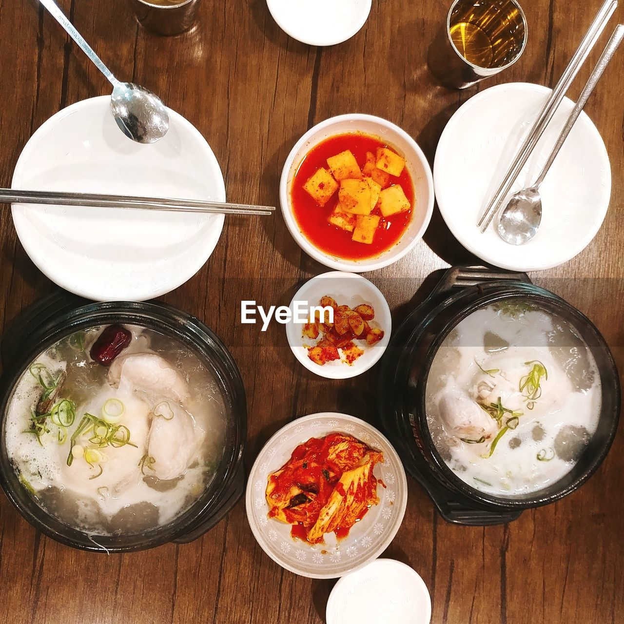 food and drink, food, table, freshness, bowl, ready-to-eat, indoors, healthy eating, wellbeing, kitchen utensil, spoon, eating utensil, high angle view, still life, plate, no people, meal, directly above, wood - material, household equipment, glass, temptation