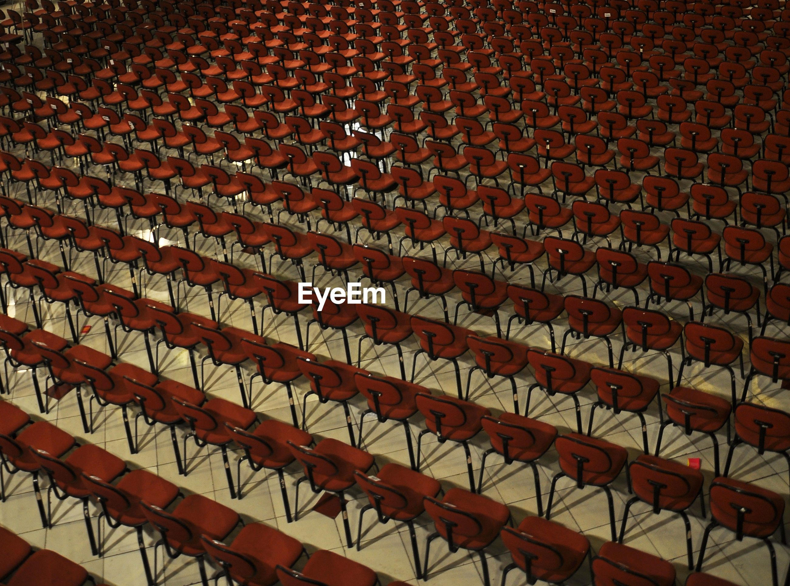 High angle view of red empty chairs