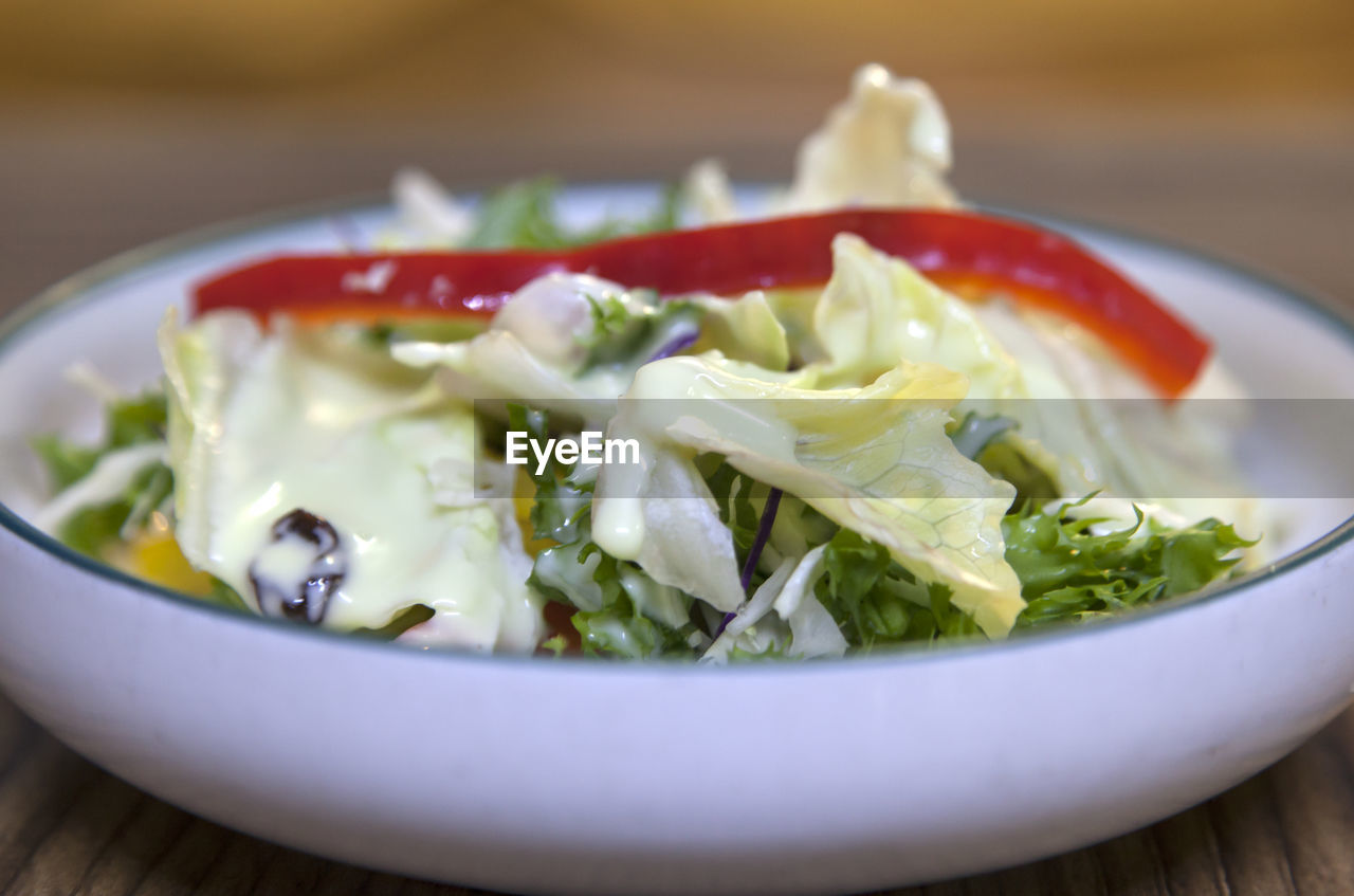 food and drink, healthy eating, food, vegetable, wellbeing, freshness, ready-to-eat, close-up, salad, still life, bowl, serving size, indoors, no people, table, fruit, plate, selective focus, tomato, vegetarian food, crockery, garnish, chopped