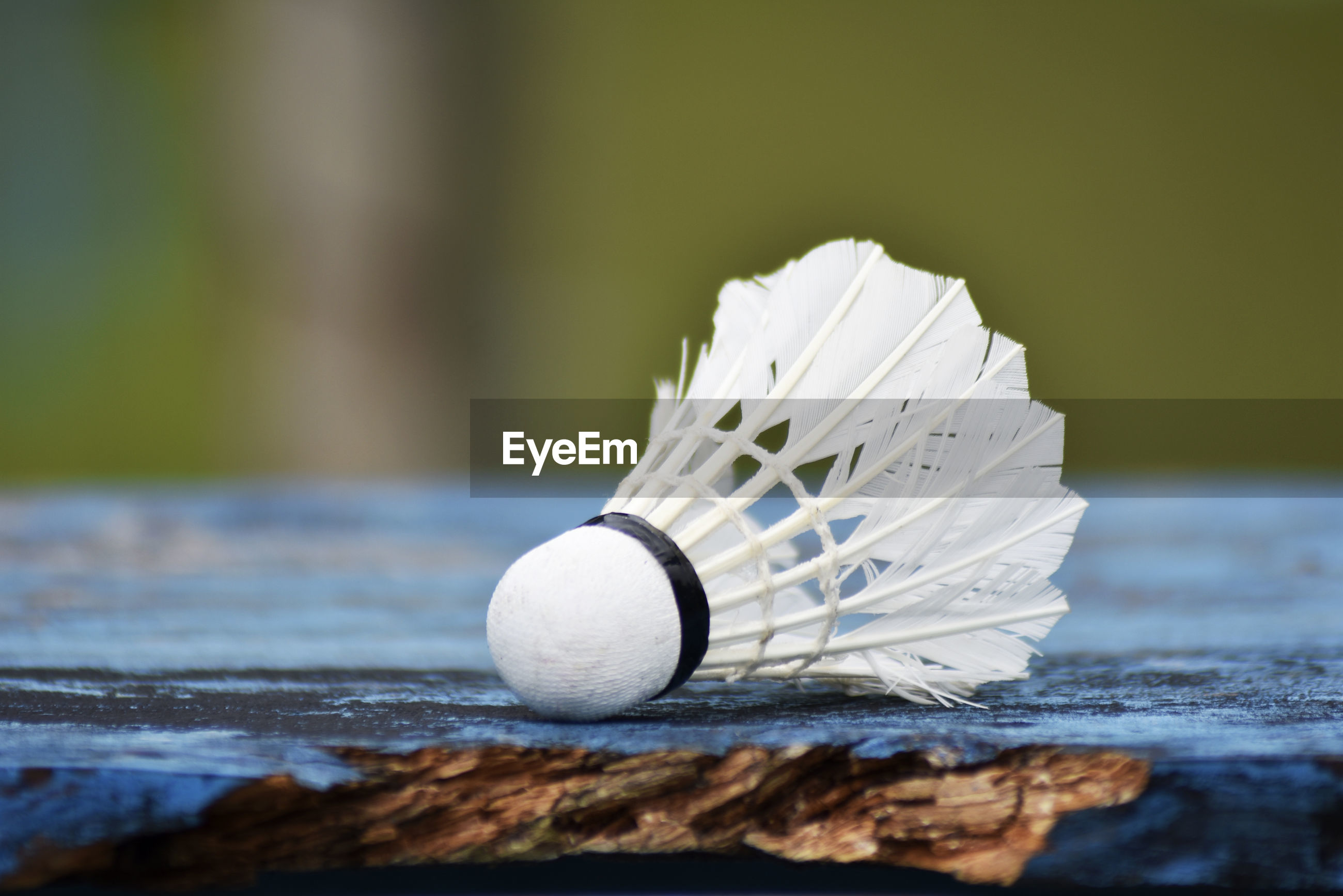 Badminton ball on a wooden table
