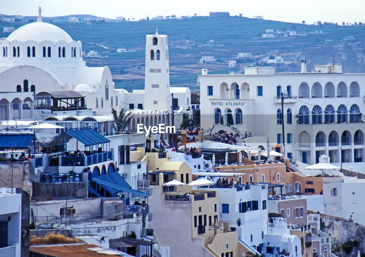 architecture, built structure, building exterior, building, city, high angle view, dome, residential district, crowded, religion, day, place of worship, nature, crowd, belief, outdoors, town, travel destinations, spirituality, cityscape, townscape, settlement