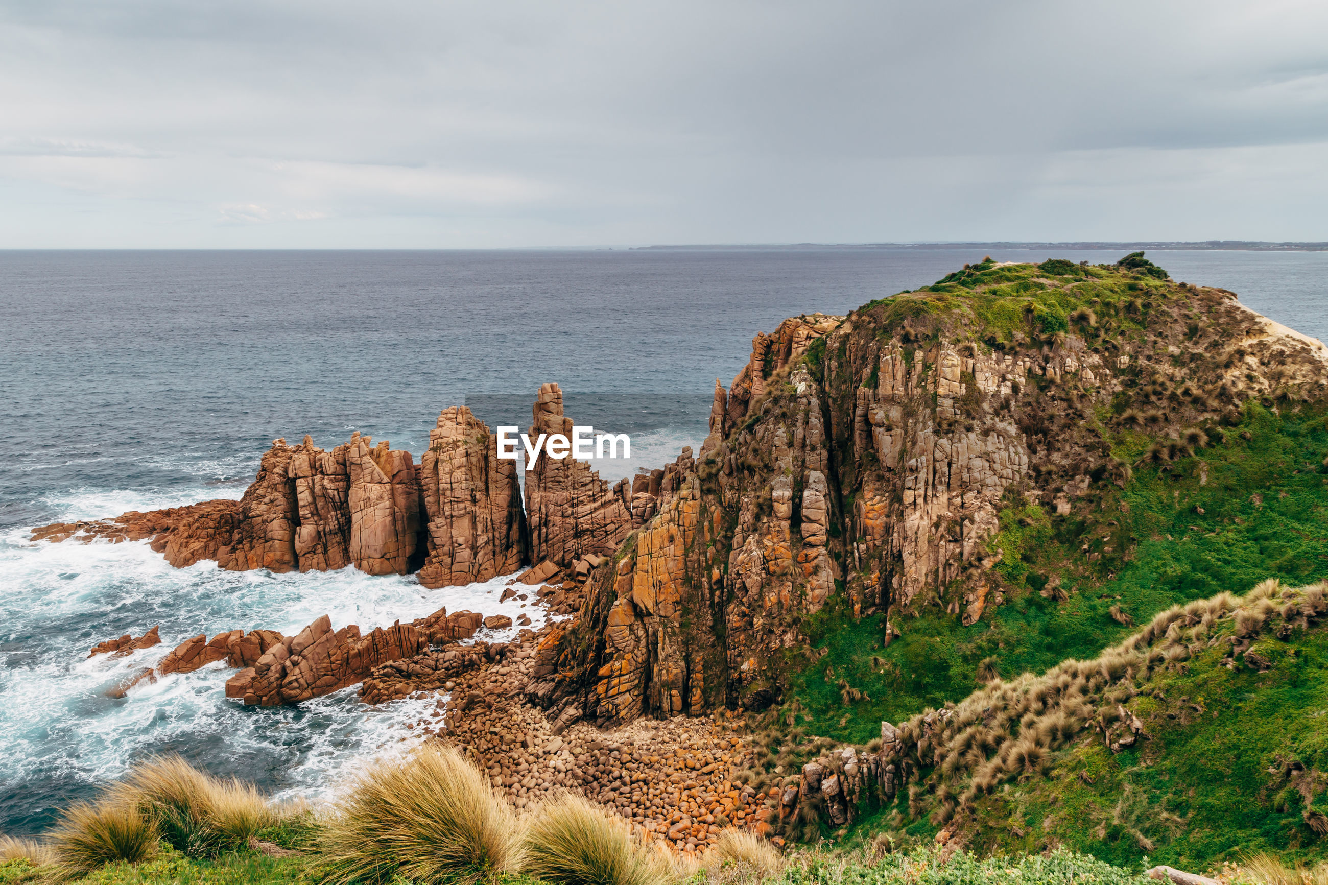 SCENIC VIEW OF SEA AND ROCKS AGAINST SKY