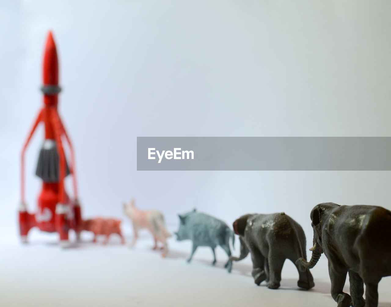 Toy Animals And Rocket On Table