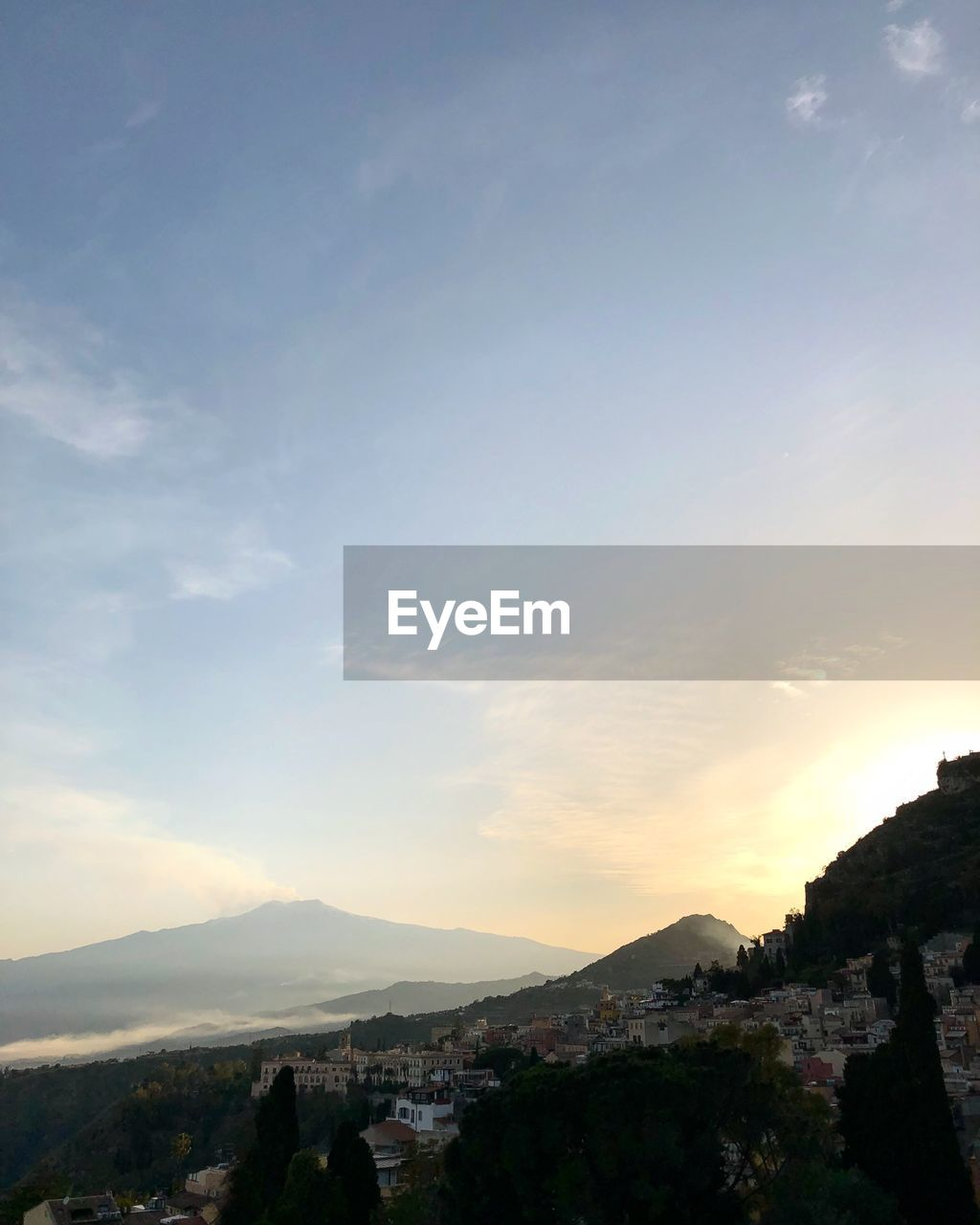 sky, mountain, cloud - sky, scenics - nature, beauty in nature, nature, sunset, architecture, building exterior, built structure, tranquility, environment, tranquil scene, landscape, outdoors, city, town, building, no people
