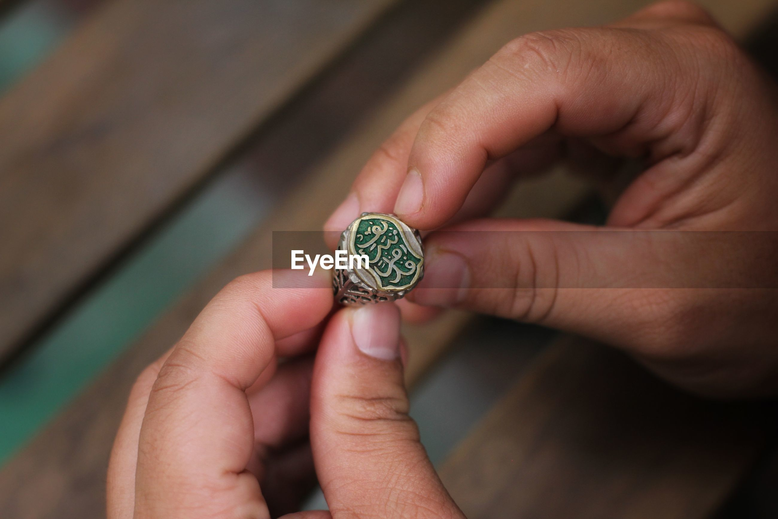 High angle view of person holding ring with text