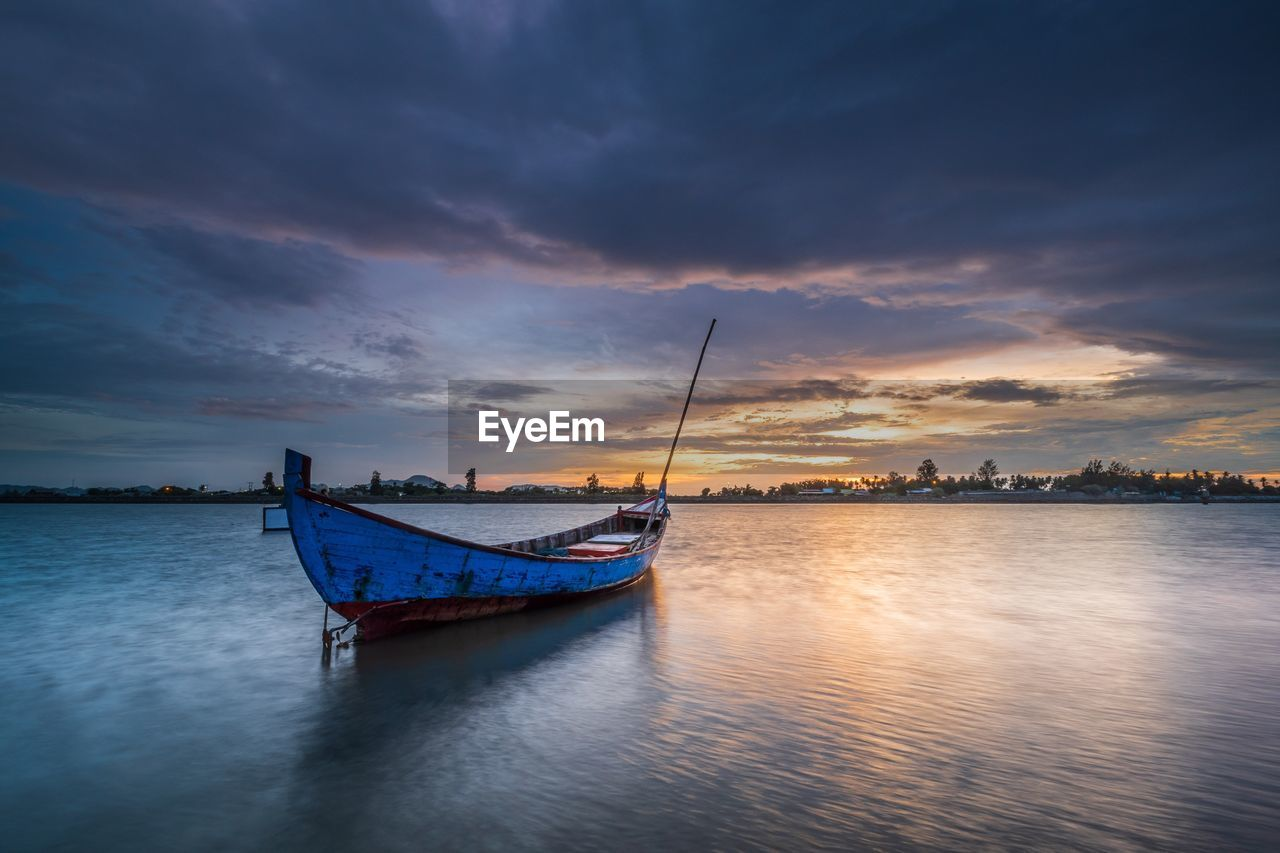 nautical vessel, sky, cloud - sky, transportation, water, mode of transportation, waterfront, sunset, beauty in nature, scenics - nature, sea, nature, tranquility, tranquil scene, moored, no people, reflection, outdoors, idyllic, fishing boat