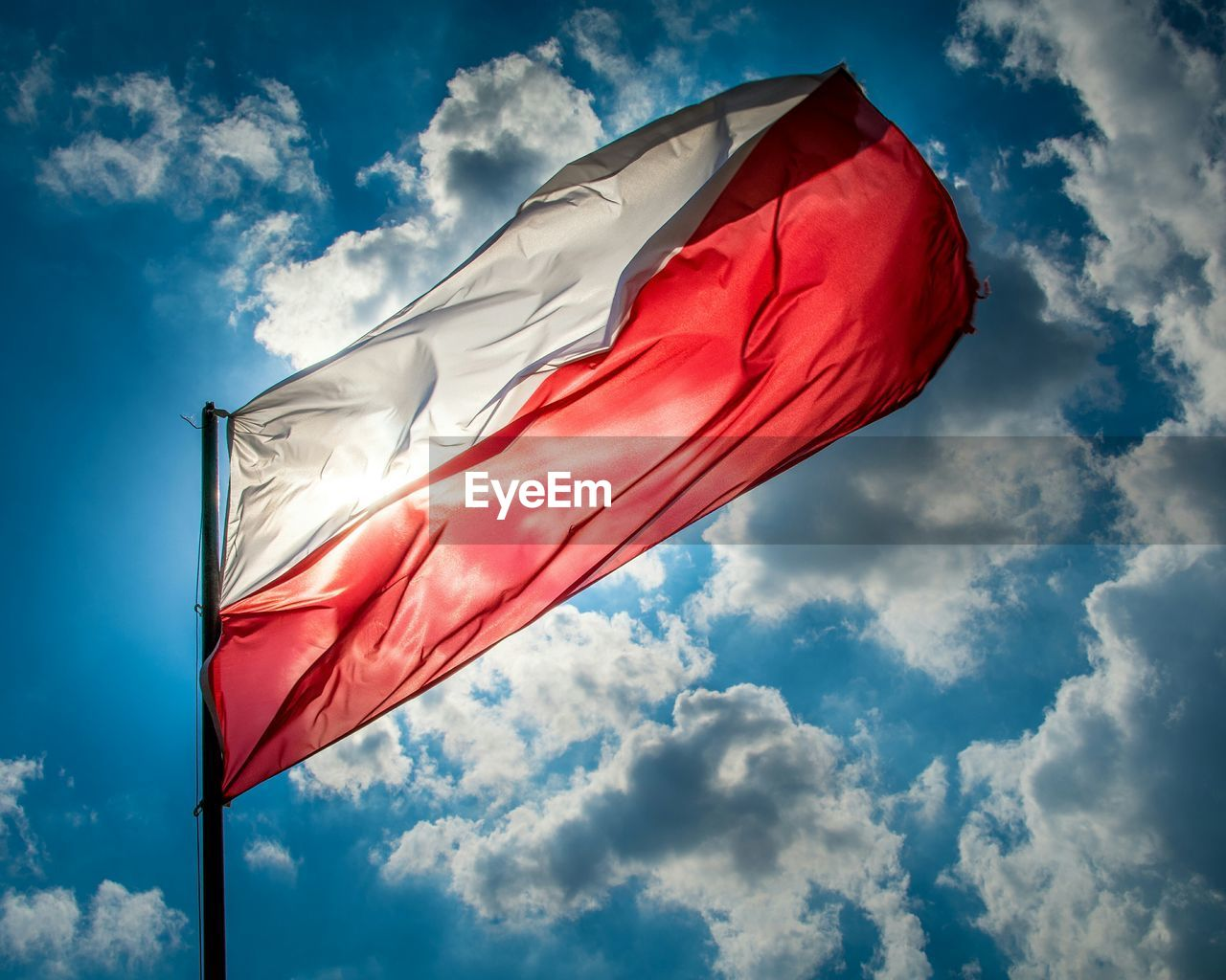 Low Angle View Of Polish Flag Against Sky