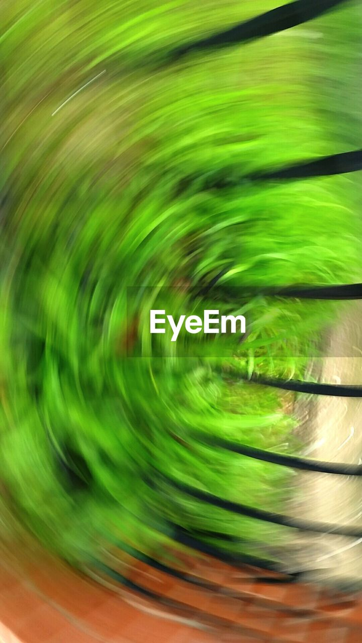 blurred motion, green color, motion, speed, abstract, concentric, no people, technology, close-up, indoors, day
