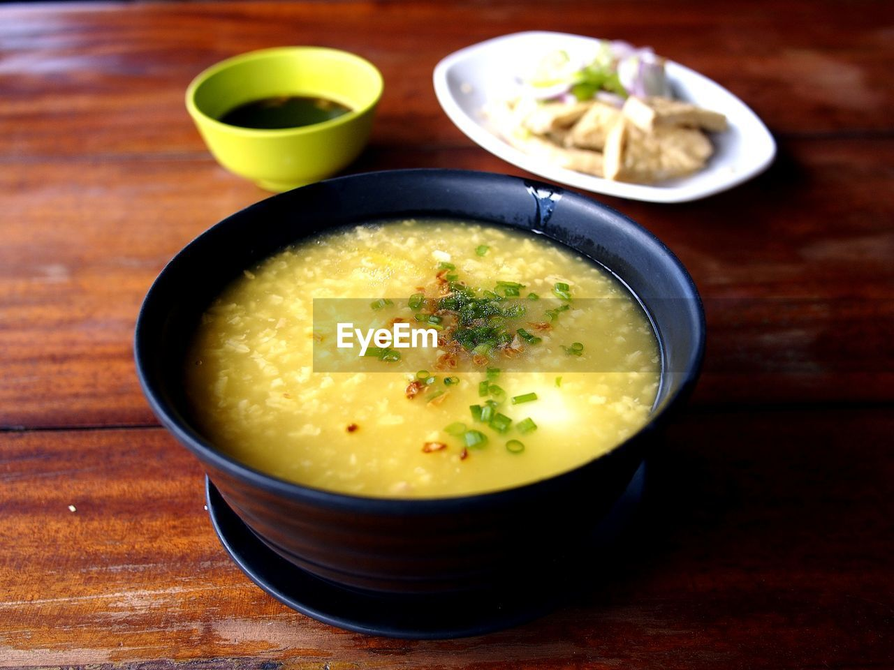 food and drink, food, table, bowl, ready-to-eat, healthy eating, freshness, wellbeing, indoors, soup, no people, still life, close-up, wood - material, serving size, high angle view, vegetable, focus on foreground, meal, garnish, vegetarian food, temptation, crockery, soup bowl