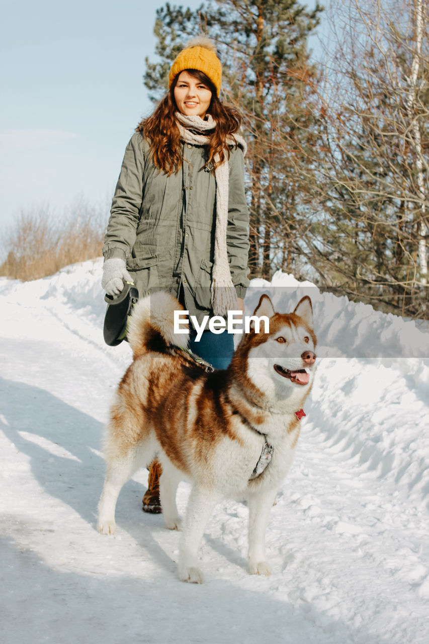 winter, snow, cold temperature, animal themes, dog, domestic animals, canine, mammal, animal, pets, clothing, warm clothing, one person, domestic, one animal, full length, nature, portrait, scarf, outdoors