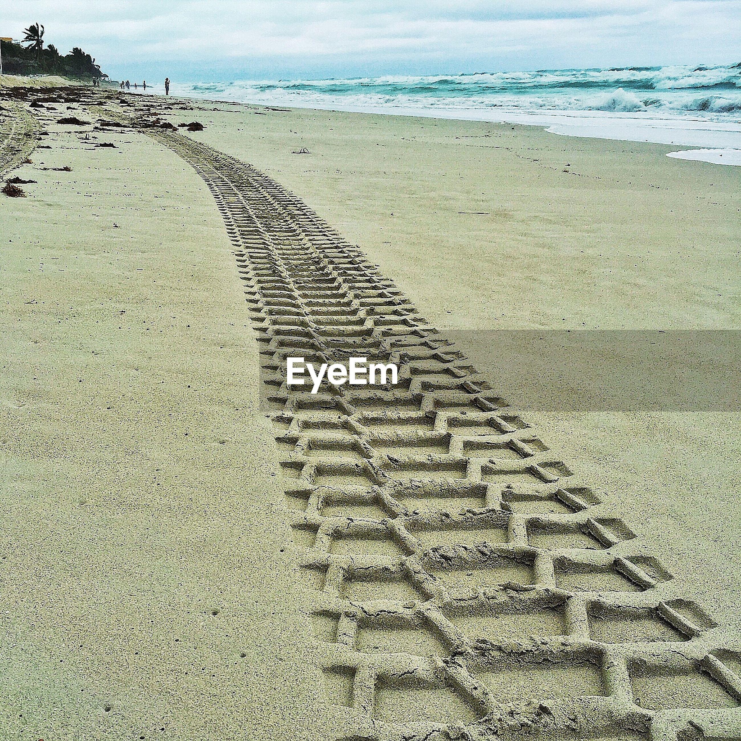 Tire tracks on beach