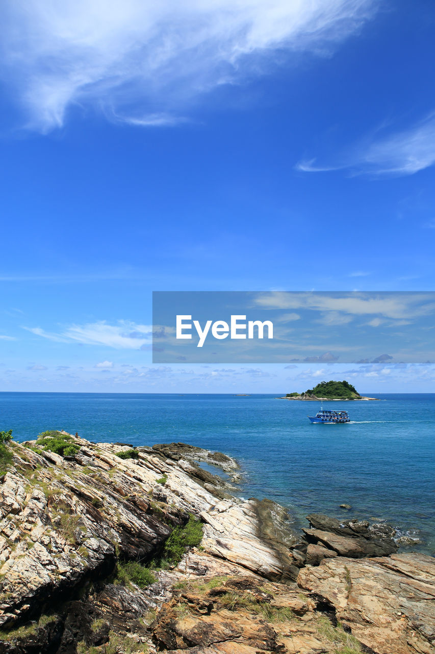 sky, sea, scenics - nature, water, cloud - sky, beauty in nature, tranquil scene, tranquility, rock, horizon over water, horizon, rock - object, land, solid, day, blue, nature, no people, idyllic, outdoors, rocky coastline