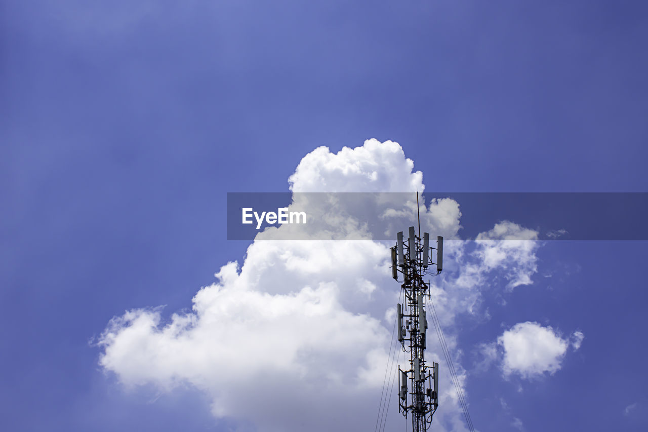 sky, cloud - sky, low angle view, communication, technology, nature, blue, tower, architecture, day, no people, outdoors, built structure, connection, tall - high, sign, guidance, direction, metal, global communications