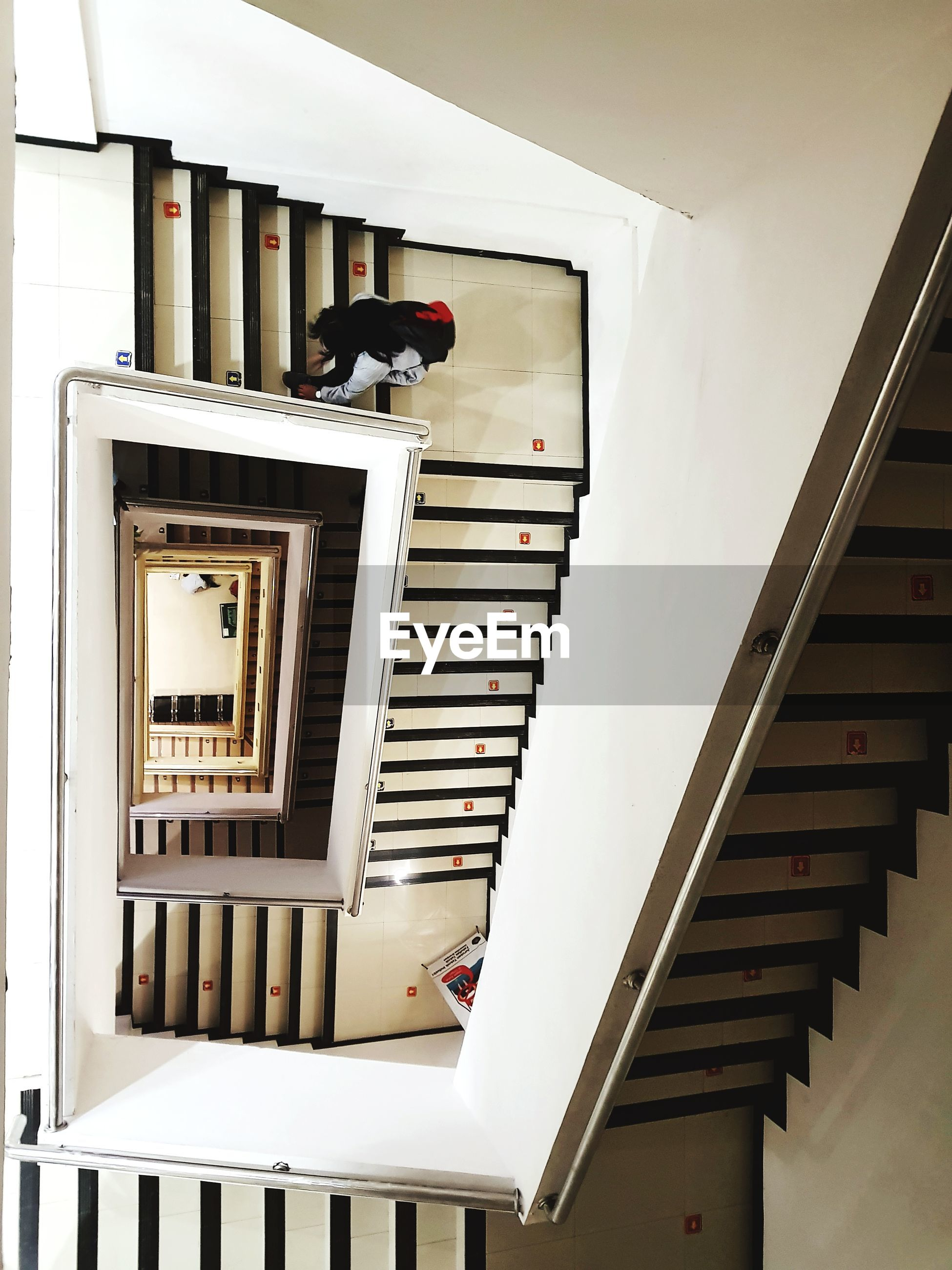 staircase, steps and staircases, architecture, built structure, steps, indoors, men, real people, low angle view, one person, building exterior, day