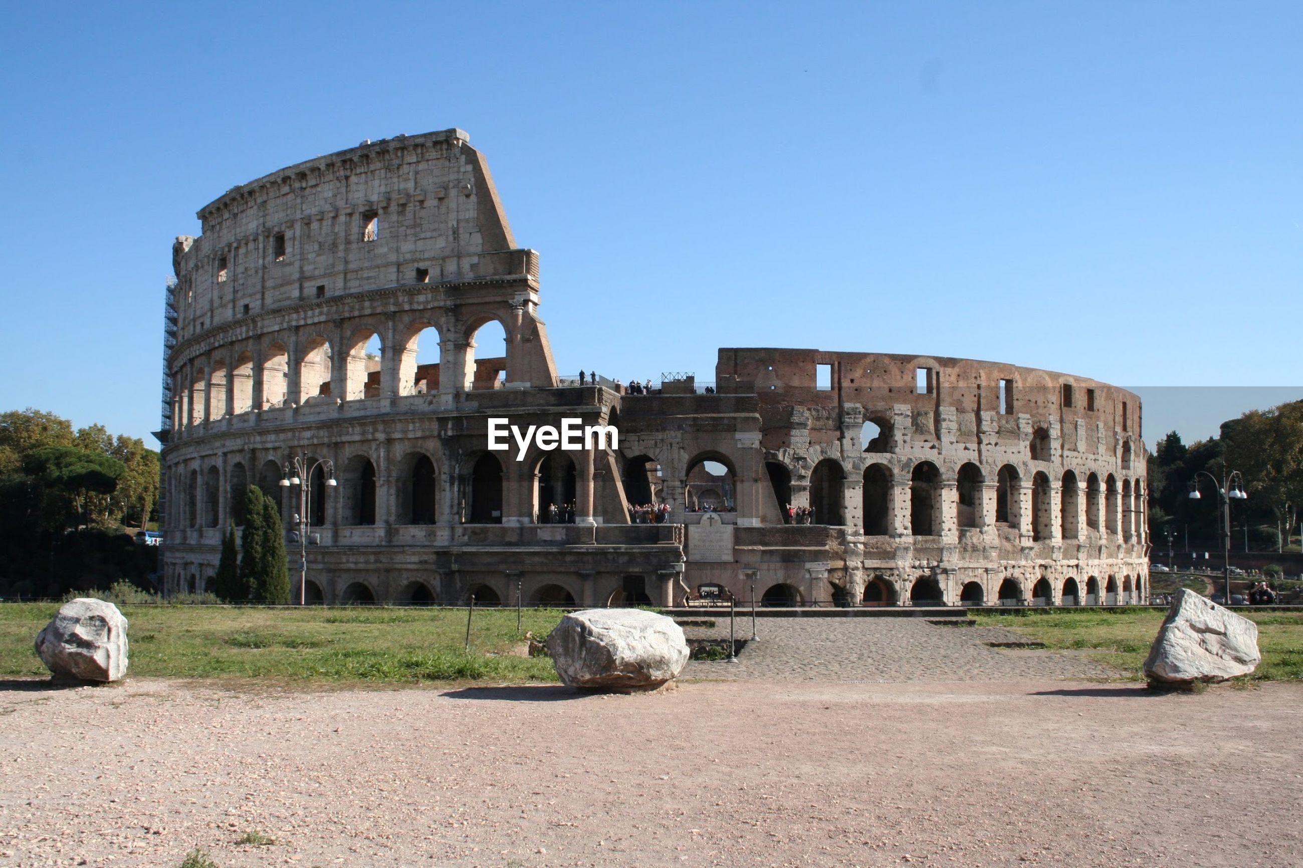 Historic ancient coliseum against sky