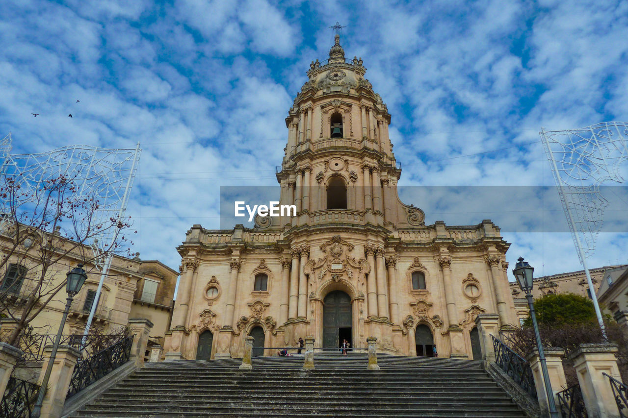 architecture, built structure, sky, building exterior, cloud - sky, low angle view, place of worship, belief, spirituality, religion, building, travel destinations, nature, the past, history, travel, day, outdoors, no people, spire