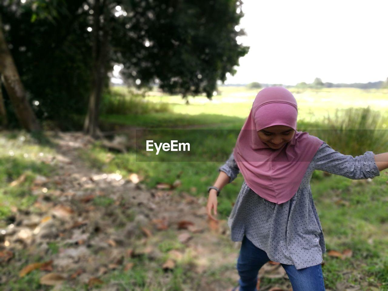 Girl Wearing Hijab Walking On Field