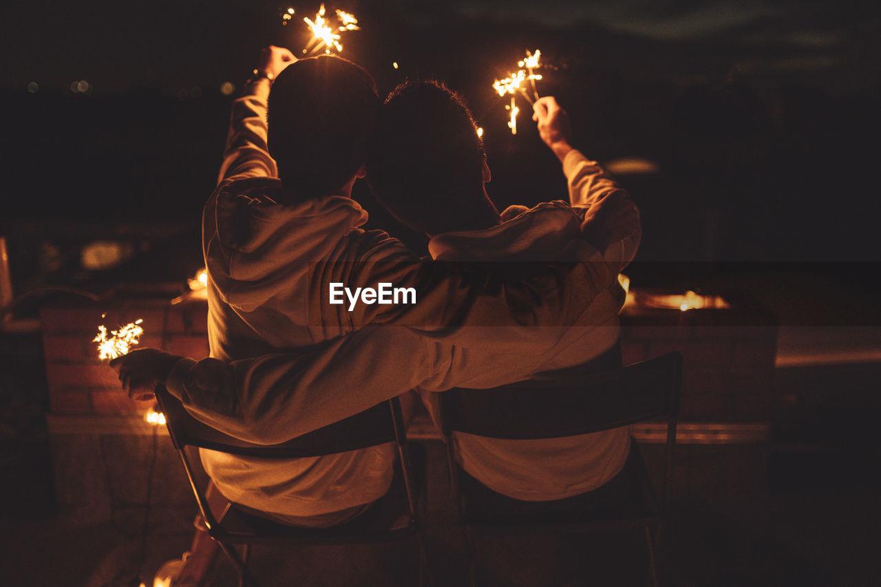 MAN AND WOMAN AT NIGHT