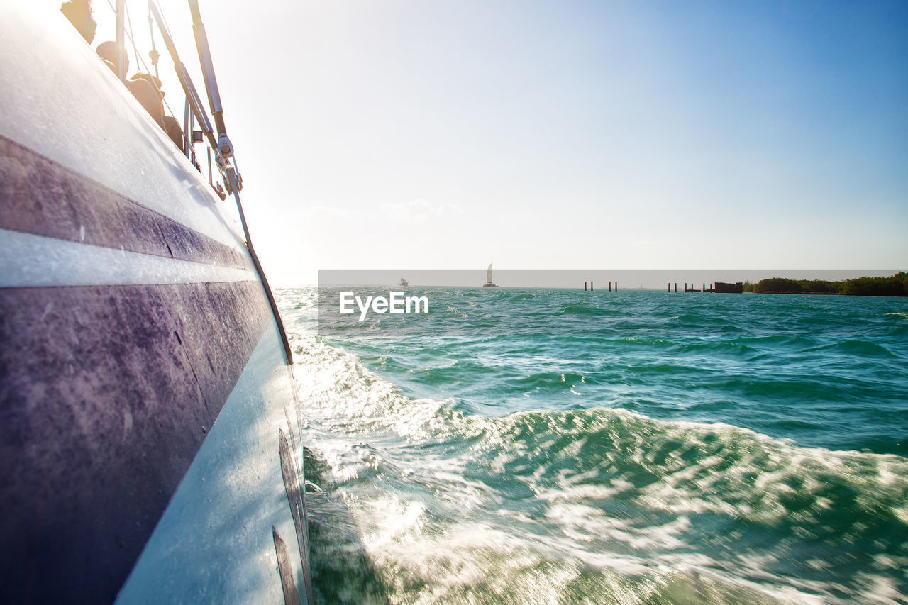 water, sea, nautical vessel, sky, transportation, mode of transportation, motion, scenics - nature, nature, wave, day, beauty in nature, no people, sport, outdoors, sunlight, clear sky, aquatic sport, sailboat, horizon over water, passenger craft, cruise ship