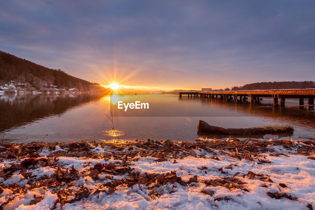 Beautiful sunset at the lake wallersee, austria, winter season