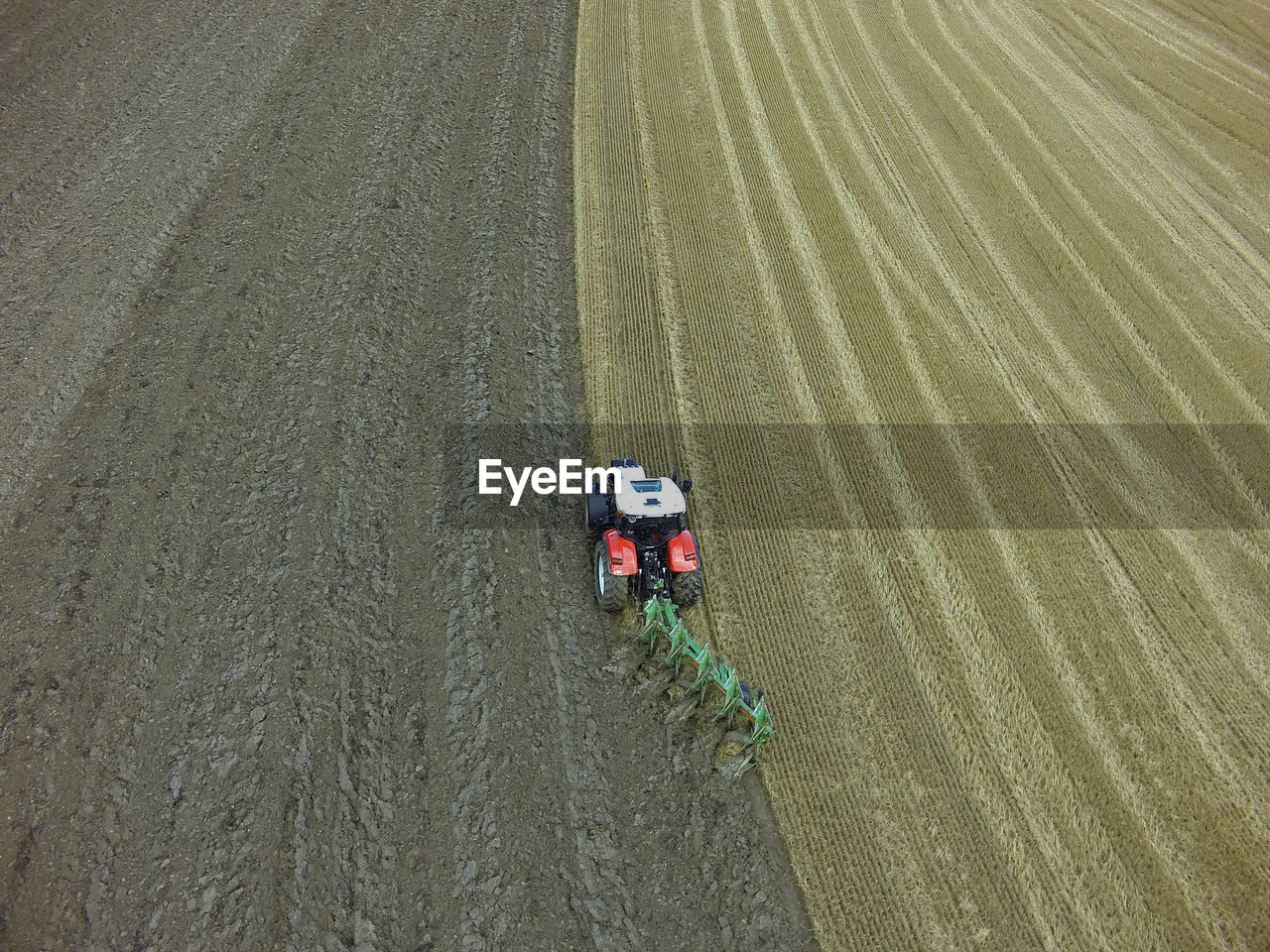 agriculture, farm, high angle view, crop, field, aerial view, rural scene, growth, farmer, one person, occupation, agricultural machinery, cereal plant, nature, working, outdoors, day, transportation, combine harvester, men, adult, one man only, adults only, people, only men