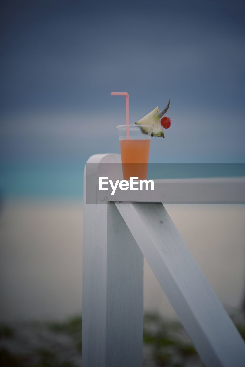 sea, drinking straw, outdoors, water, nature, no people, day, sky, horizon over water, one animal, cocktail, close-up, beach, drink, bird
