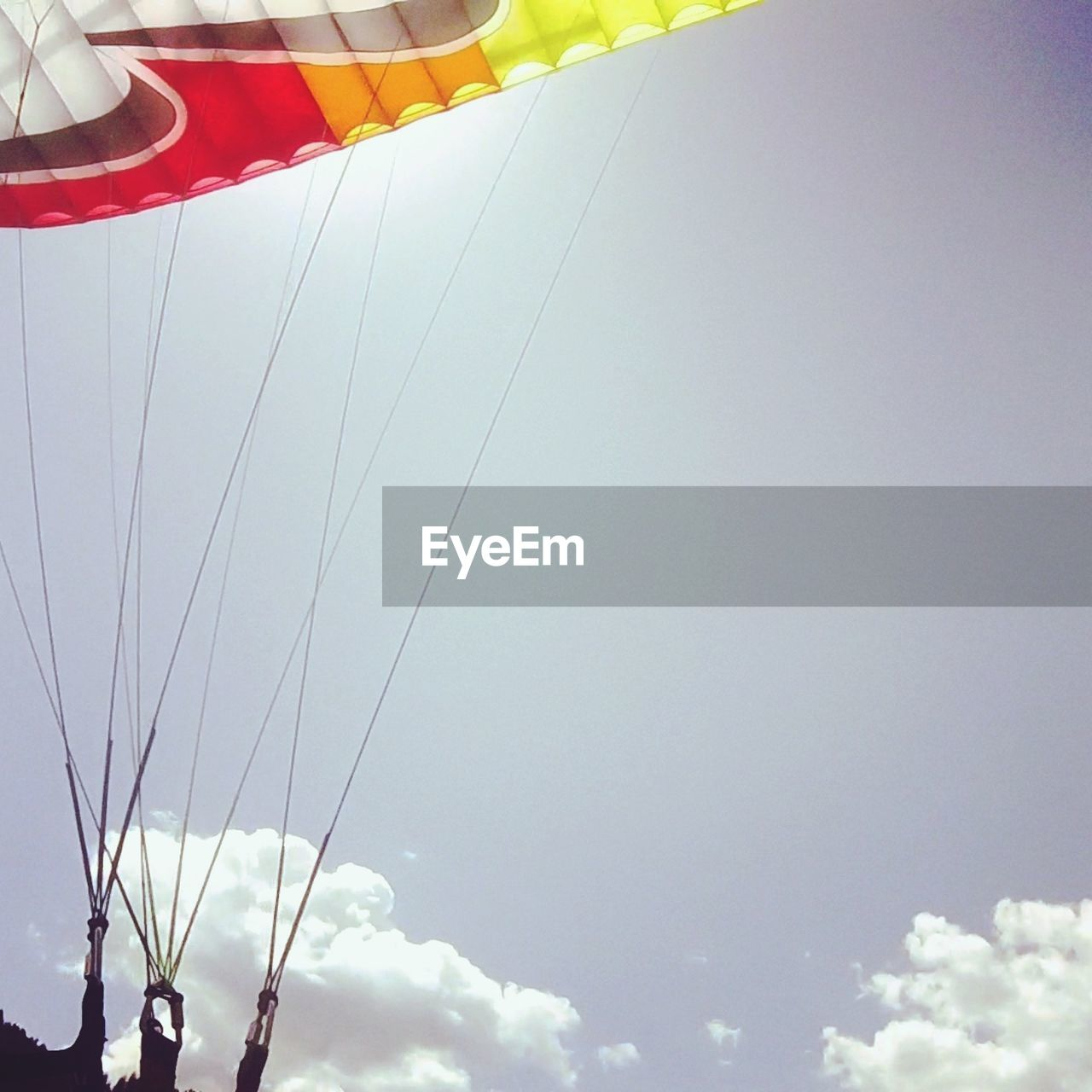 sky, low angle view, cloud - sky, nature, day, no people, outdoors, amusement park ride, arts culture and entertainment, amusement park, flying, adventure, mid-air, chain swing ride, leisure activity, parachute, freedom, copy space, transportation, sunlight, excitement