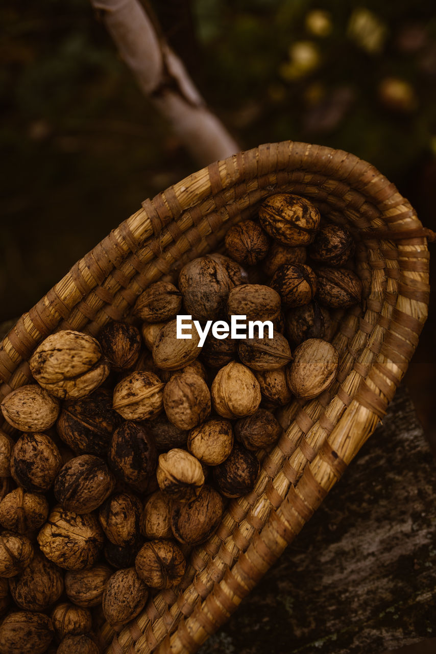 HIGH ANGLE VIEW OF COFFEE BEANS IN WICKER BASKET