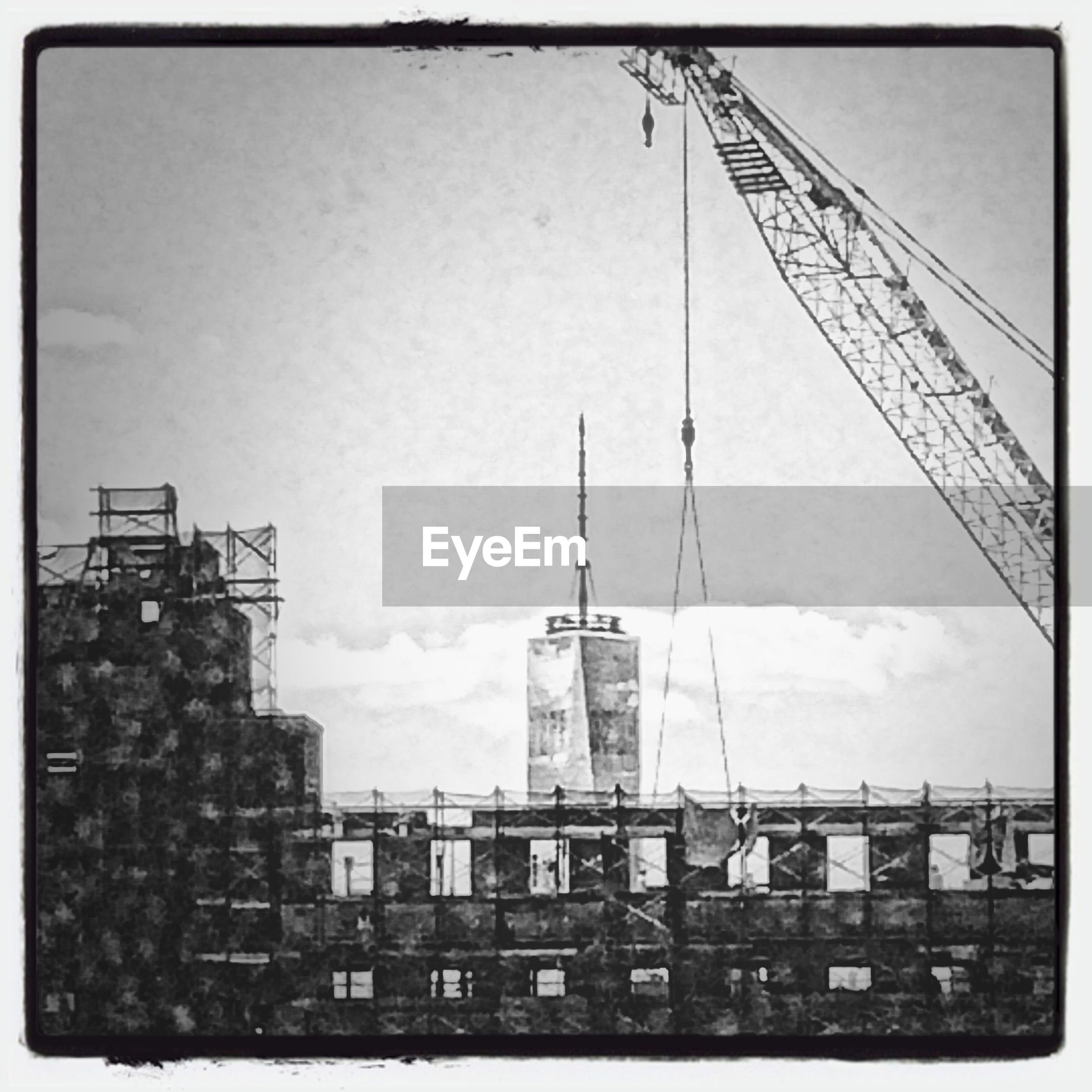 transfer print, architecture, building exterior, built structure, auto post production filter, low angle view, sky, city, building, tower, outdoors, day, no people, tall - high, window, residential building, communication, construction site, development, clear sky