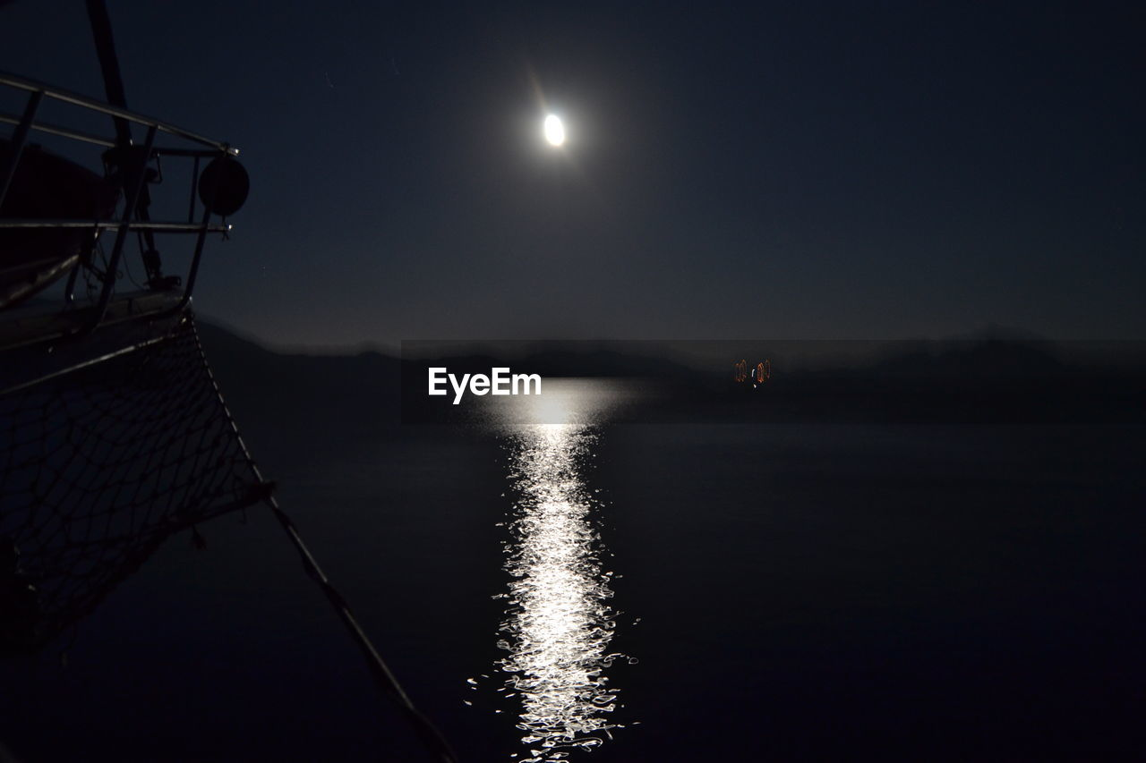 water, sky, moon, nature, no people, beauty in nature, night, scenics - nature, moonlight, reflection, outdoors, full moon, lake, tranquility, waterfront, transportation, tranquil scene, nautical vessel, planetary moon